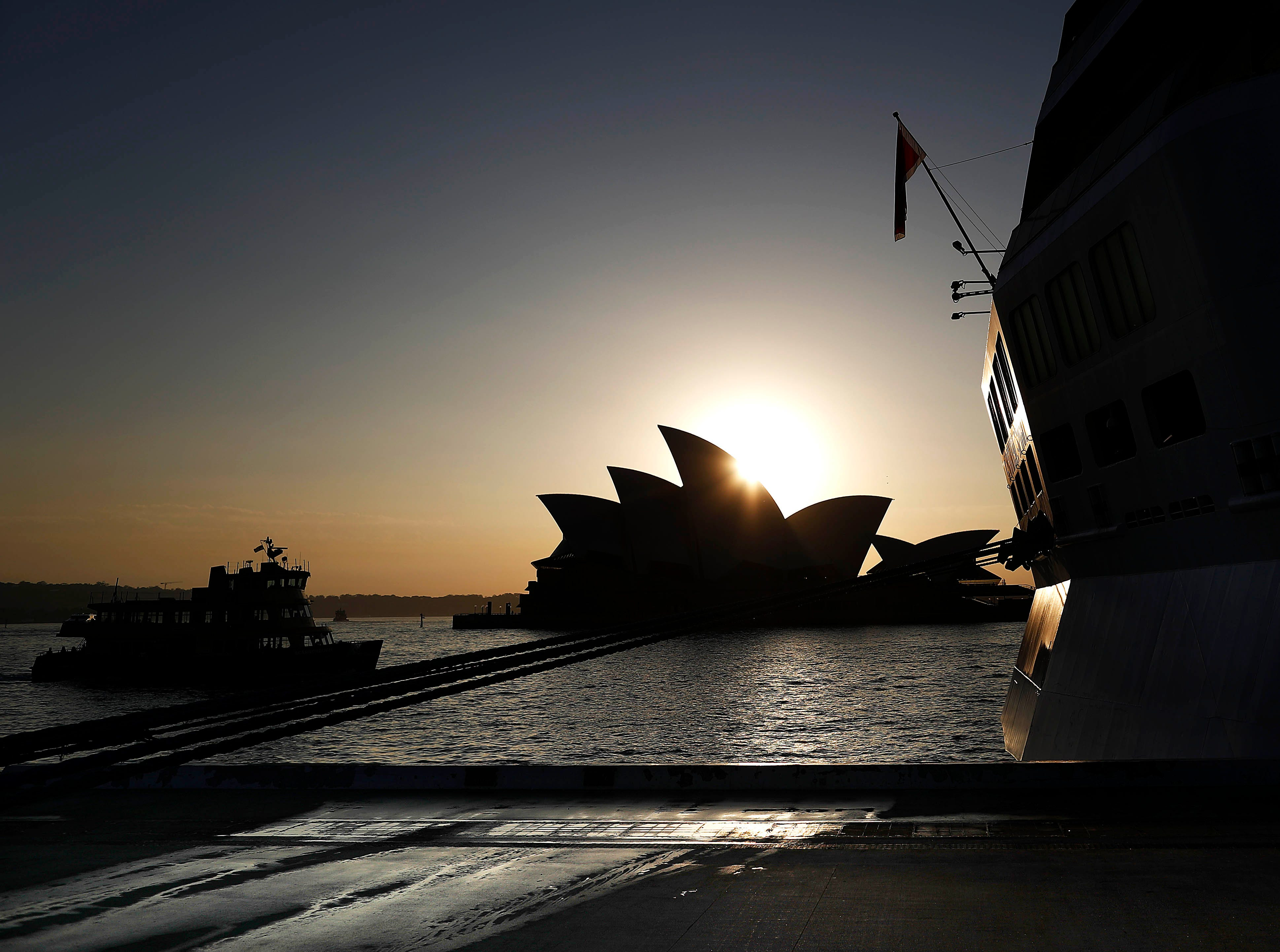 SYDNEY, AUSTRALIA - MARCH 12: A Ferry passes the Sydney Opera House at sunrise on March 12, 2019 in Sydney, Australia. (Photo by Ryan Pierse/Getty Images) ORG XMIT: 775314122 ORIG FILE ID: 1135208734