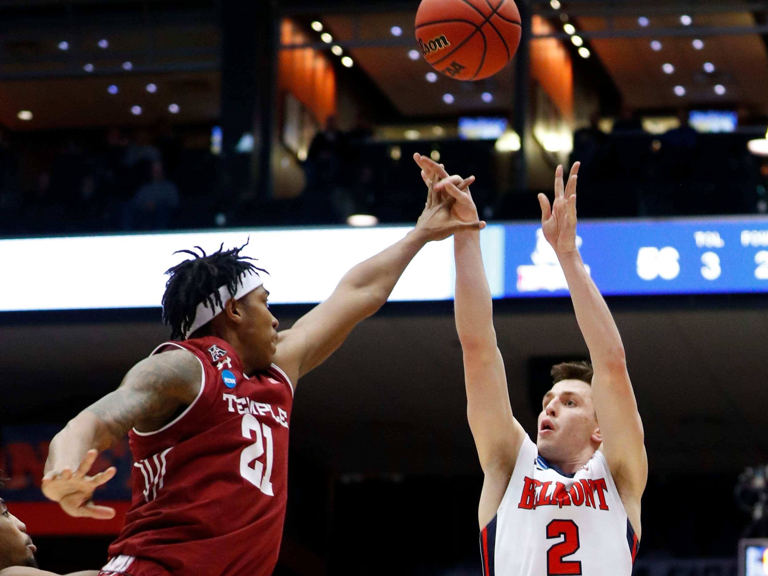 Belmont Bruins guard Grayson Murphy shoots the ball over Temple Owls forward Justyn Hamilton.