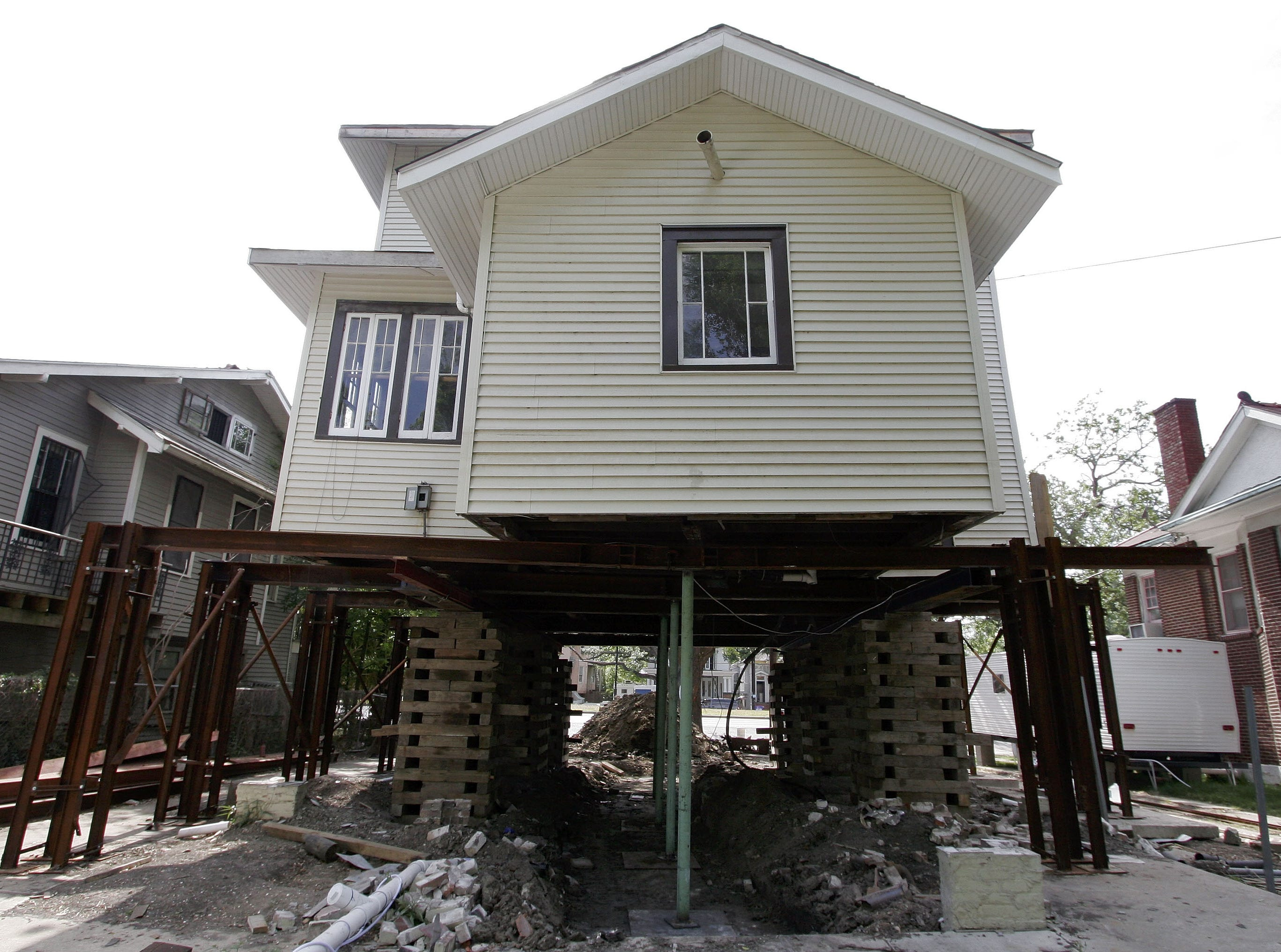 A house on Napoleon Avenue in the Broadmoor area that has been raised an additional 7 feet is seen in New Orleans, Wednesday, April 12, 2006. The house was 3 feet above the ground and still sustained damage in the aftermath of Hurricane Katrina. After the work is done, the house will be over 10 feet above the ground.