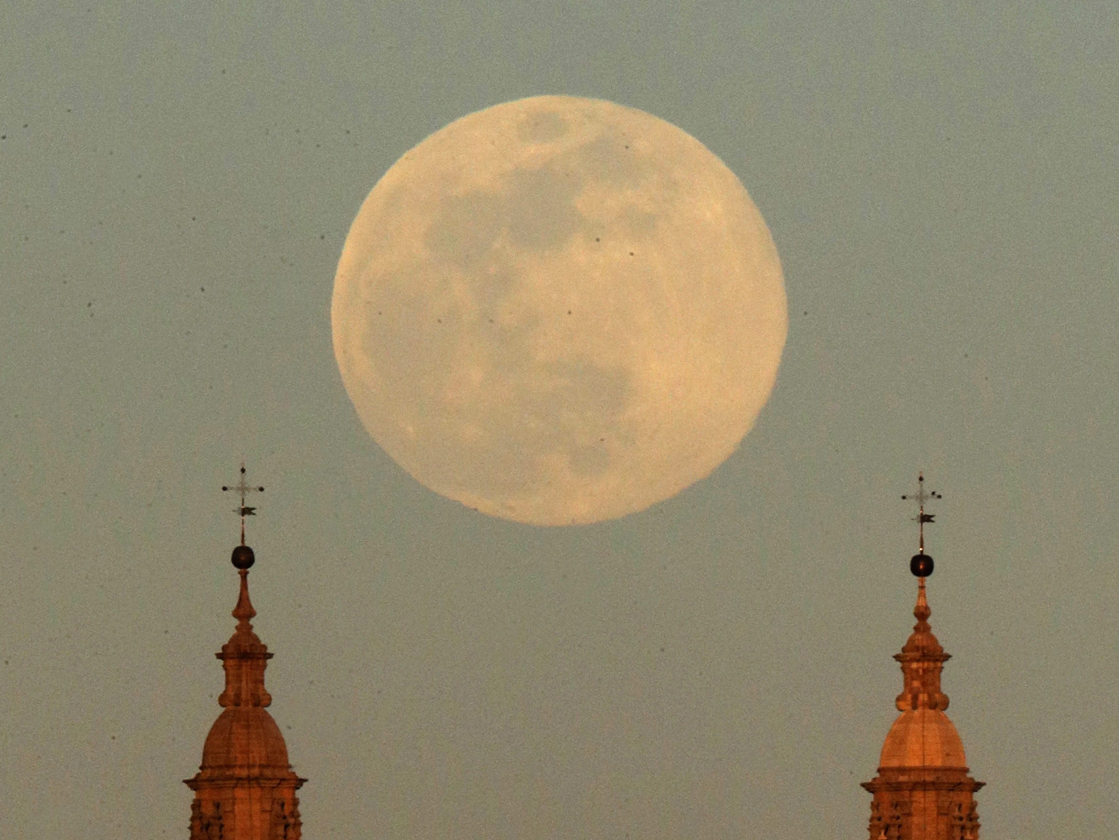A view of the supermoon that announces the start of the spring over the Santiago de Compostela cathedral, Galicia, Spain on March 20, 2019.