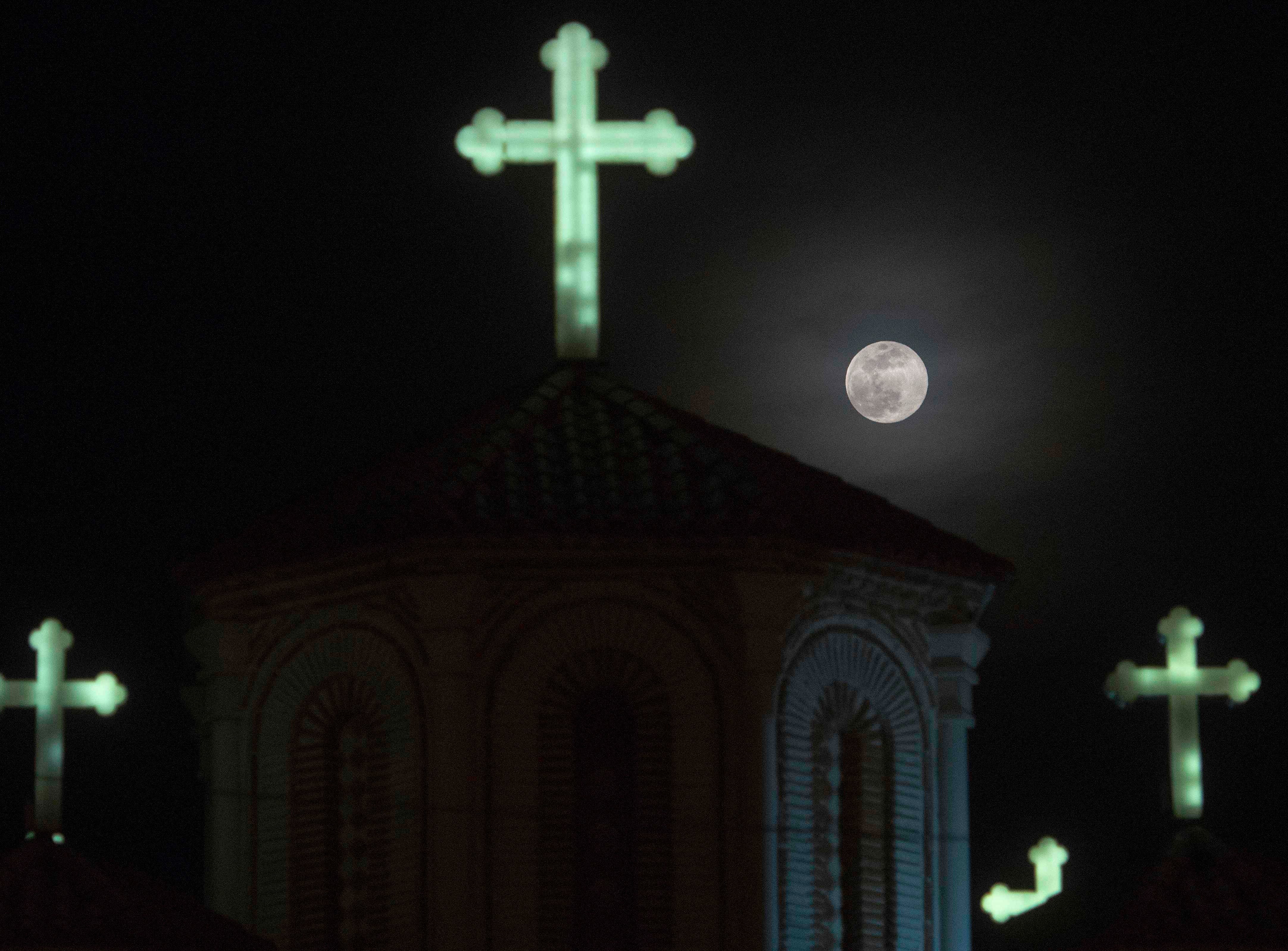 A full moon, announcing the end of the winter season, rises over a Church in Skopje, North Macedonia on March 20, 2019.