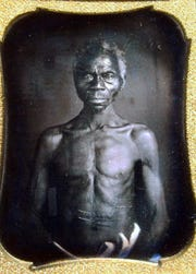 This July 17, 2018 copy photo shows a 1850 Daguerreotype of Renty, a South Carolina slave who Tamara Lanier said is her family's patriarch. The portrait was commissioned by Harvard biologist Louis Agassiz, whose ideas were used to support the enslavement of Africans in the United States.