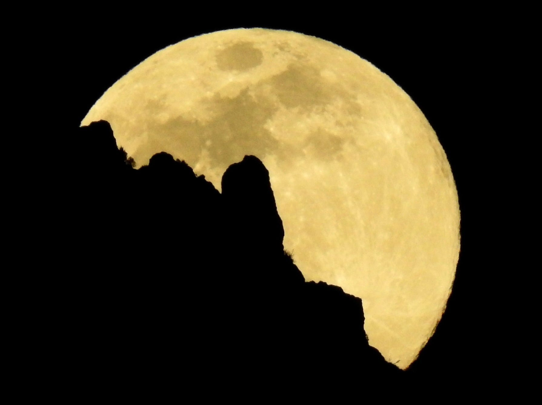 A view of the supermoon that announces the start of the spring over the Pico Sacro mountain from Santiago de Compostela, Galicia, Spain March 20, 2019.