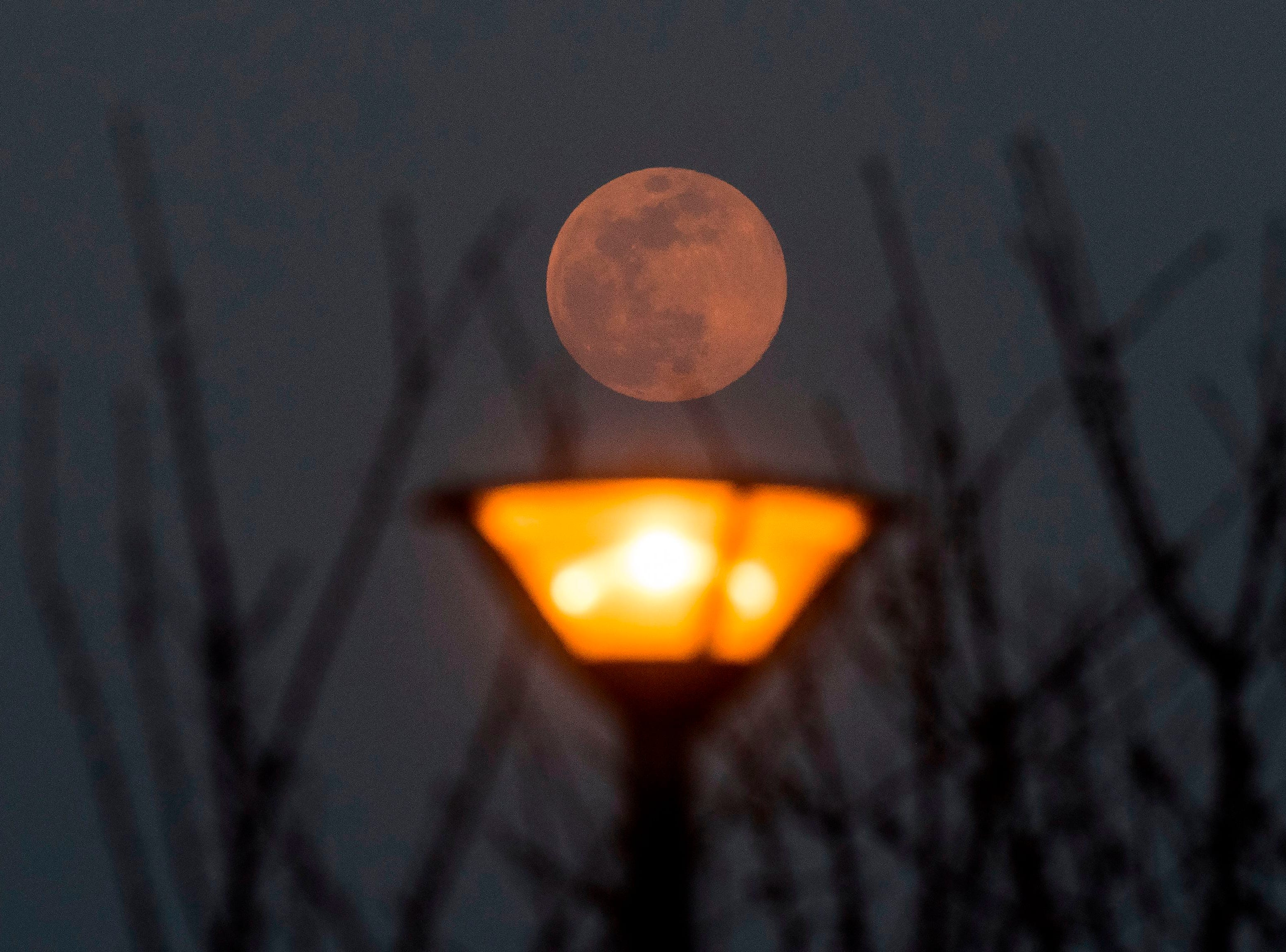 A full moon, announcing the end of the winter season, rises in Skopje, North Macedonia on March 20, 2019.