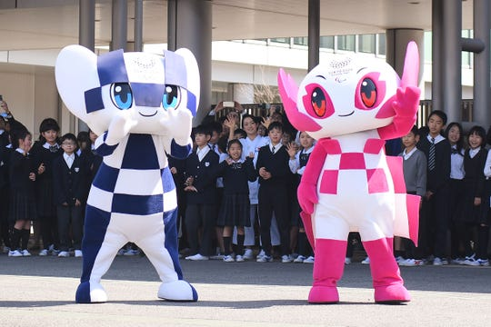 Tokyo 2020 mascots Miraitowa (L) and Someity (R) attend the Tokyo 2020 caravan bus departure event at the Panasonic Center Tokyo on March 12, 2019 in Tokyo.