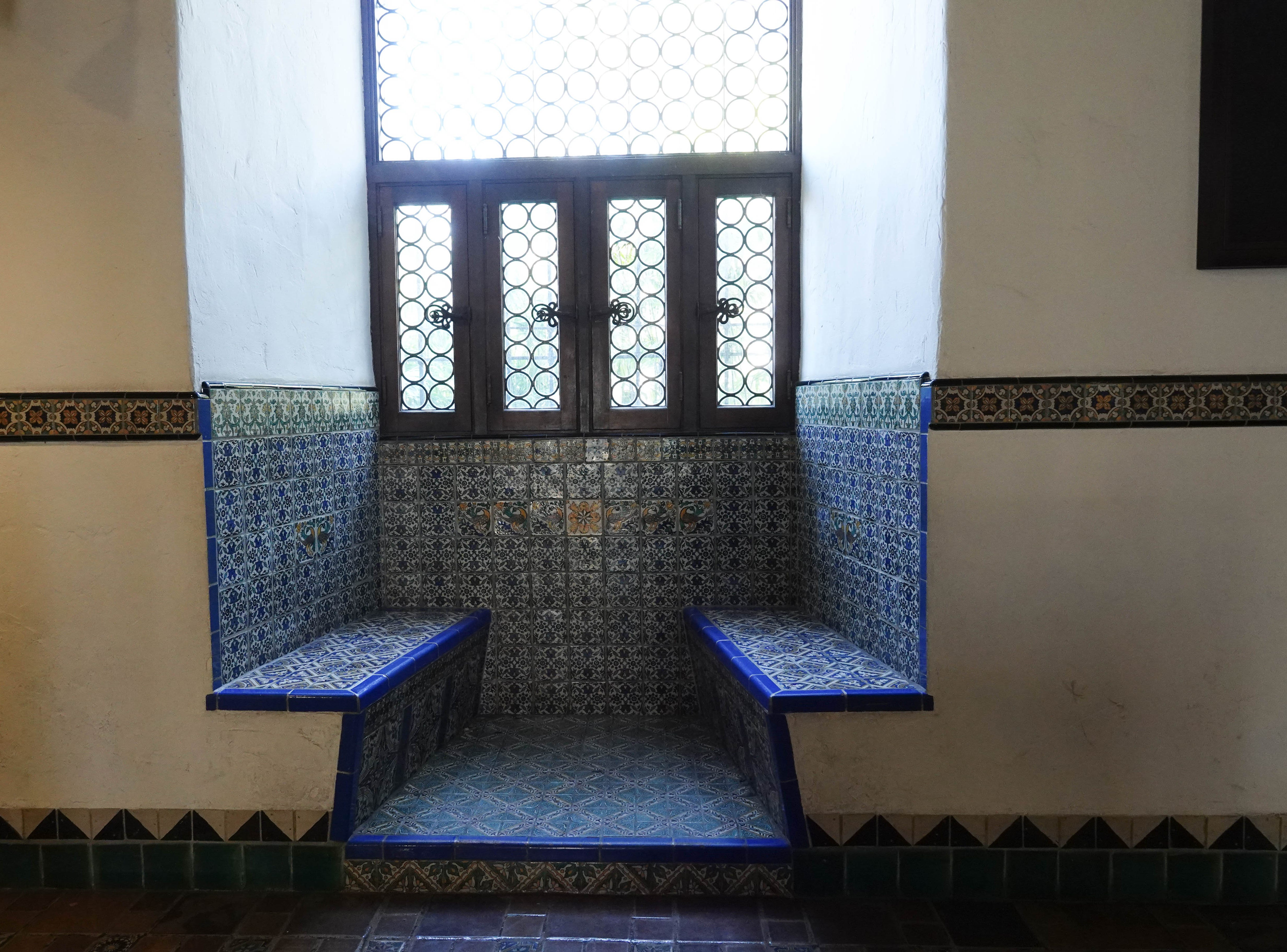 Mosaic-tiled seating.