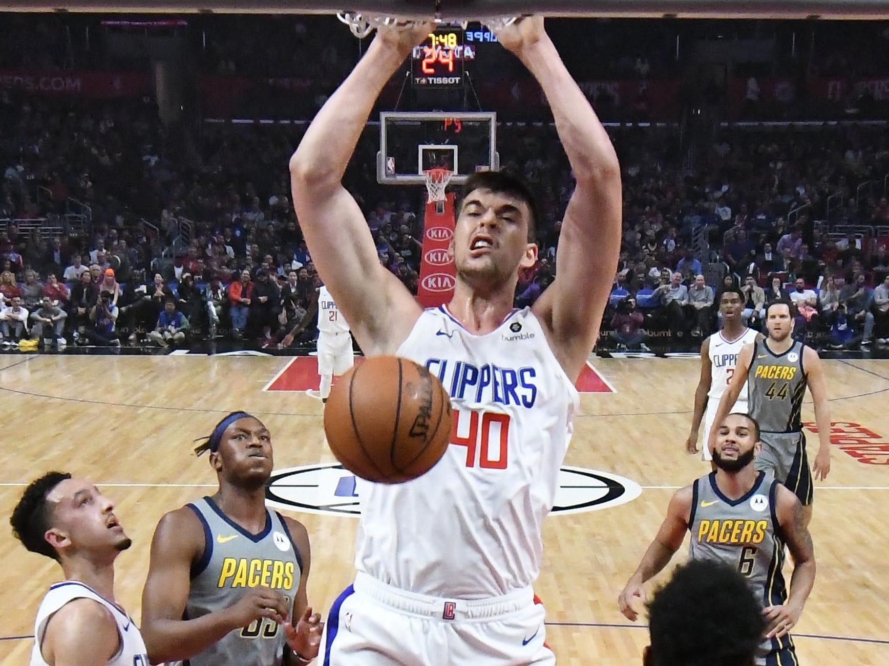 March 19: Clippers center Ivica Zubac throws down the thunderous two-handed finish against the Pacers in Los Angeles.