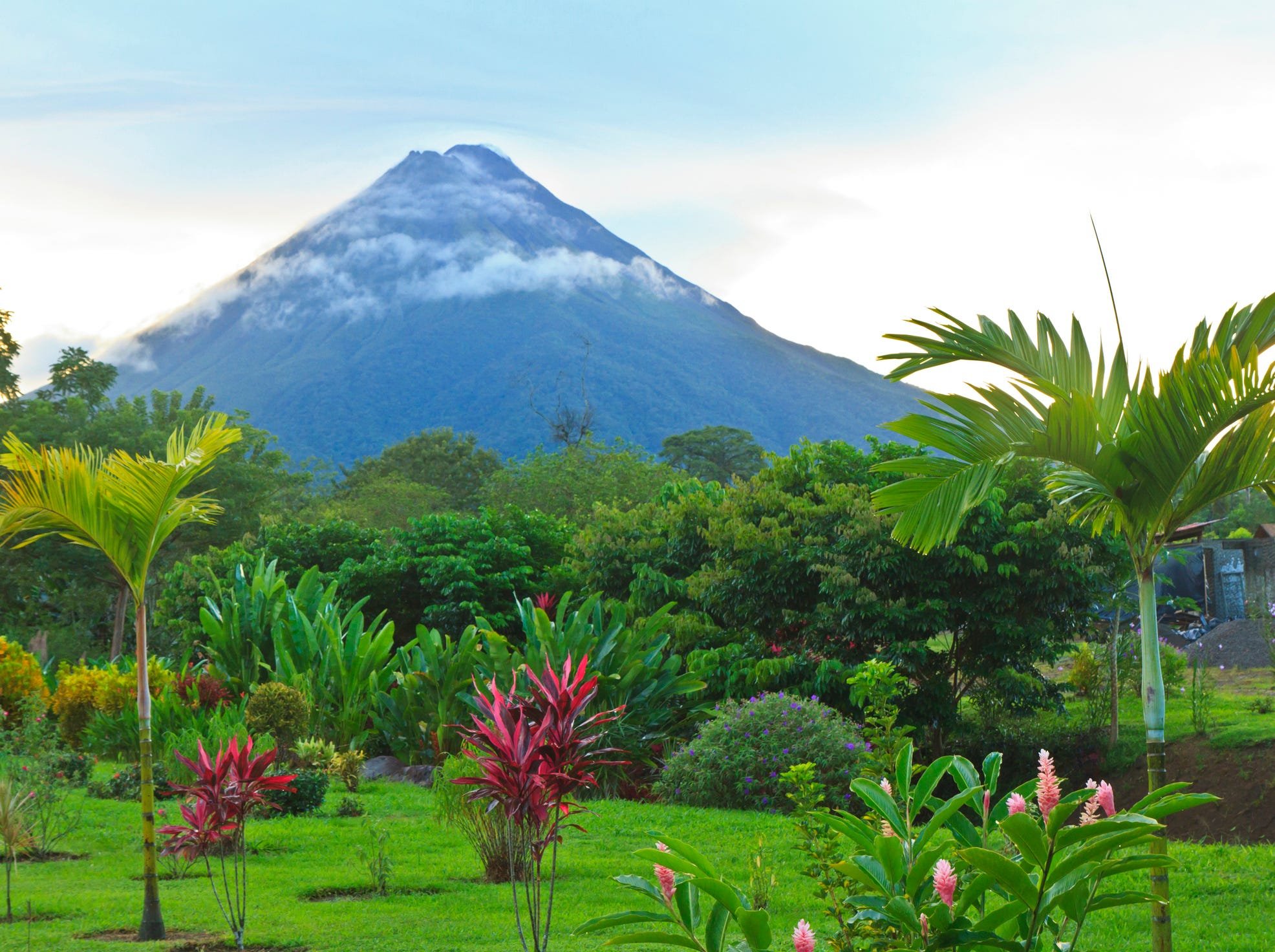 A lush garden in La Fortuna, Costa Rica with Arenal Volcano in the background.  Colin Young, Getty Images/ iStockphoto (Via OlyDrop)