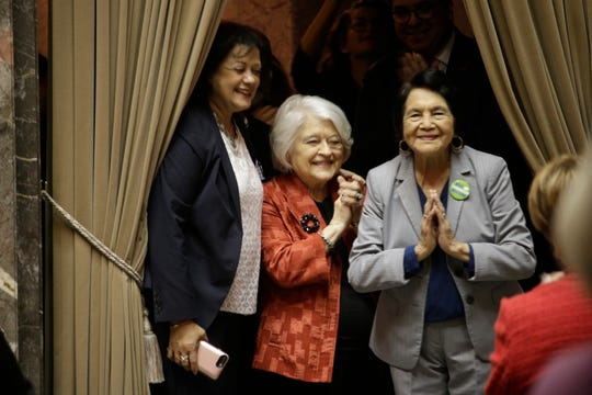 "Dolores Huerta, far right, thanks senators after the unanimous vote to designate April 10 as ""Dolores Huerta Day,"" on Monday, March 18, 2019, in Olympia, Wash. The House had already passed the measure honoring Huerta, the Mexican-American social activist who formed a farmworkers union with Cesar Chavez. (AP Photo/Rachel La Corte)"
