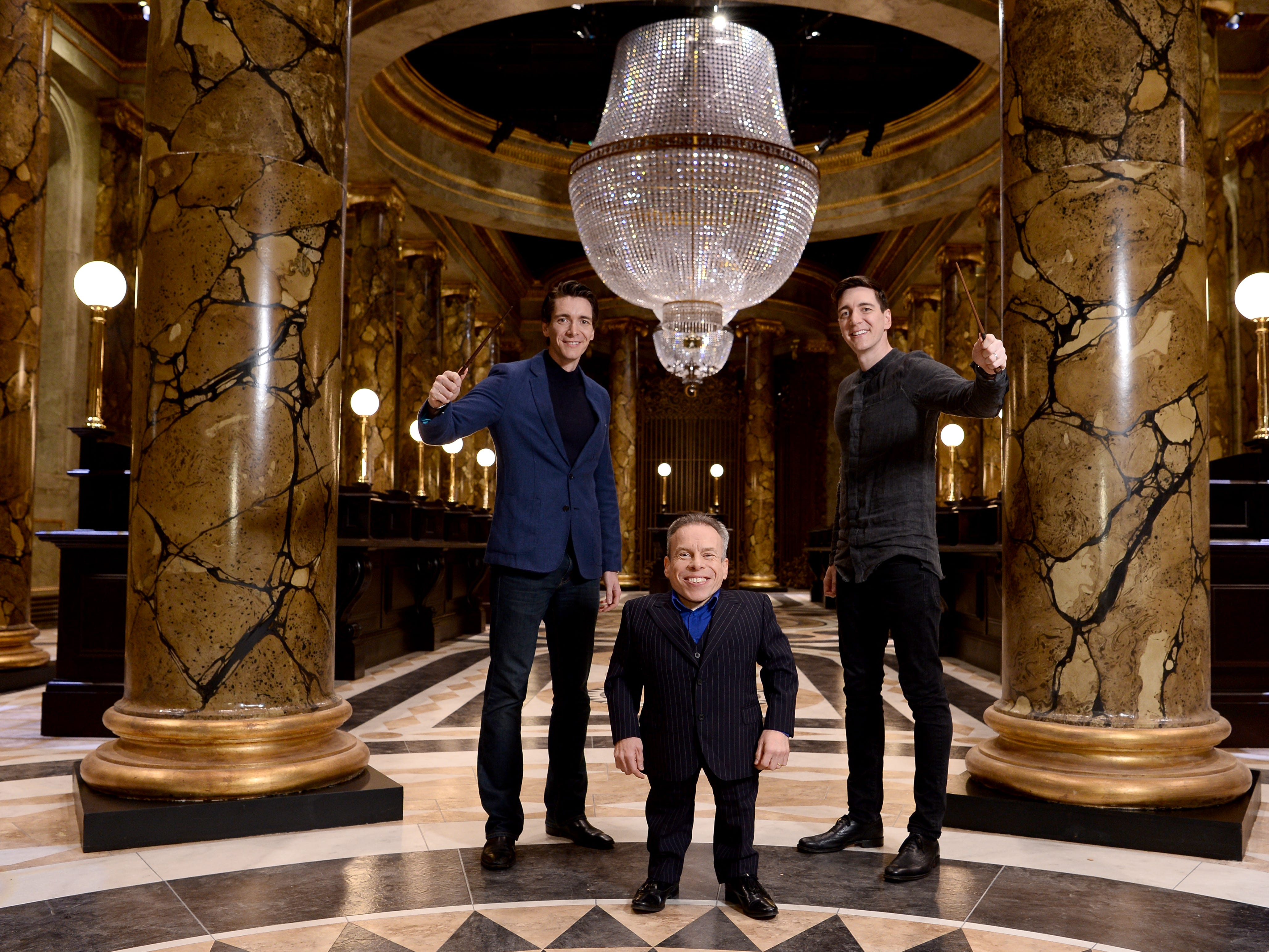 WATFORD, ENGLAND - MARCH 19:  (L-R) Oliver Phelps, Warwick Davis and James Phelps in the original Gringotts Wizarding Bank set at Warner Bros. Studio Tour London on March 19, 2019 in Watford, England. Warner Bros. Studio Tour London  The Making of Harry Potter unveils its biggest expansion to date, the original Gringotts Wizarding Bank will be open to the public from Saturday 6th April. (Photo by Jeff Spicer/Getty Images for Warner Bros. Studio Tour London) ORG XMIT: 775316730 ORIG FILE ID: 1136771919