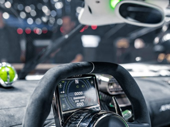The Jesko features a new steering-wheel-mounted display screen that moves with the wheel.