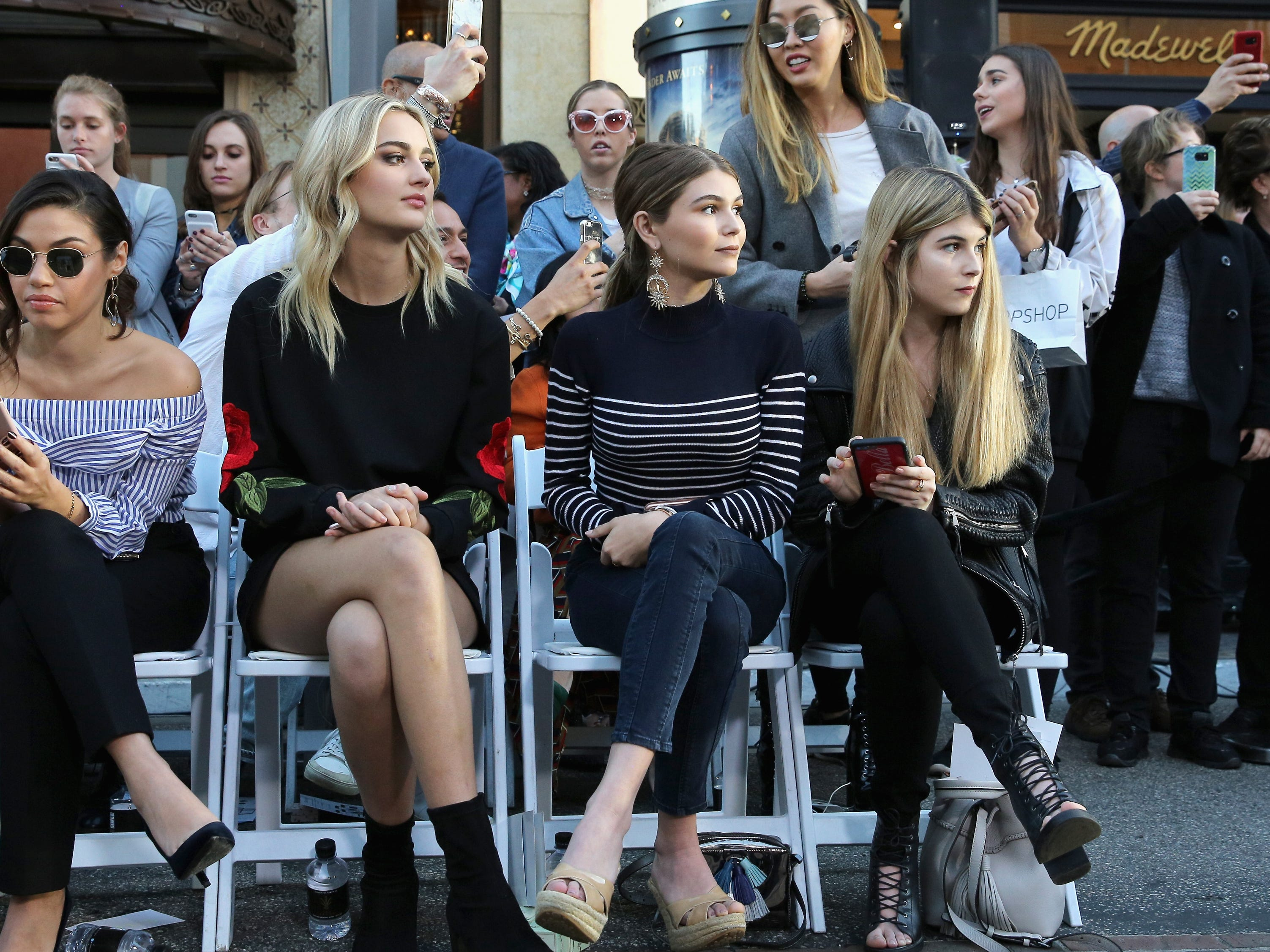 Olivia Giannulli, center, and guests attend designer Rebecca Minkoff's Spring 2017 See Now, Buy Now Fashion Show at The Grove on Feb. 4, 2017, in Los Angeles.
