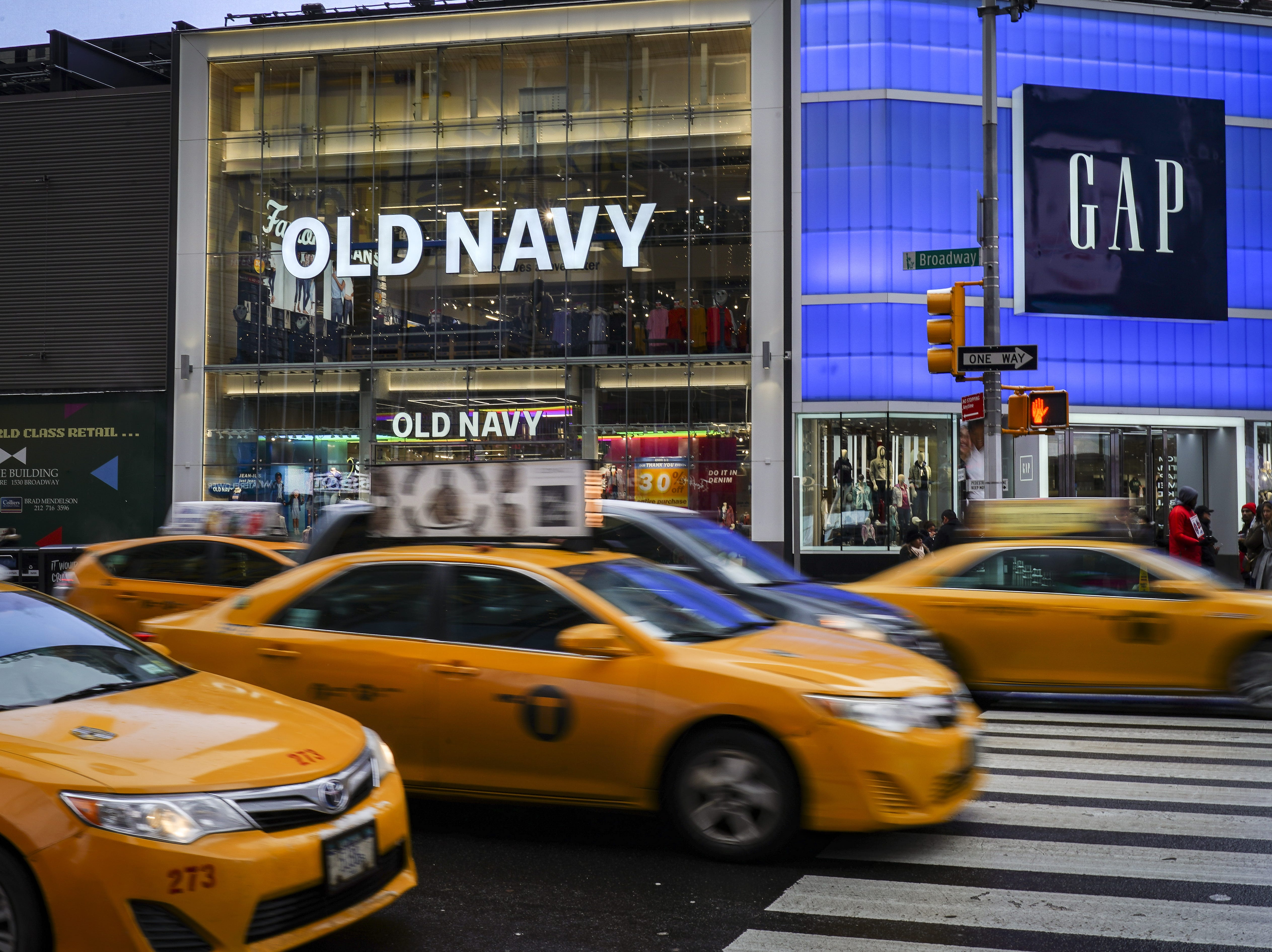 NEW YORK, NY - MARCH 01: Traffic passes by an Old Navy and GAP stores in Times Square, March 1, 2019 in New York City. On Thursday, Gap Inc. announced plans to separate into two publicly traded companies, spinning off Old Navy into a separate firm as it closes about 230 Gap stores over the next two years. According to Gap Inc., Old Navy will become its own company, and the other company, which has not been named yet, will consist of the Gap brand, Athleta, Banana Republic, Intermix and Hill City. (Photo by Drew Angerer/Getty Images) ORG XMIT: 775307132 ORIG FILE ID: 1128300951