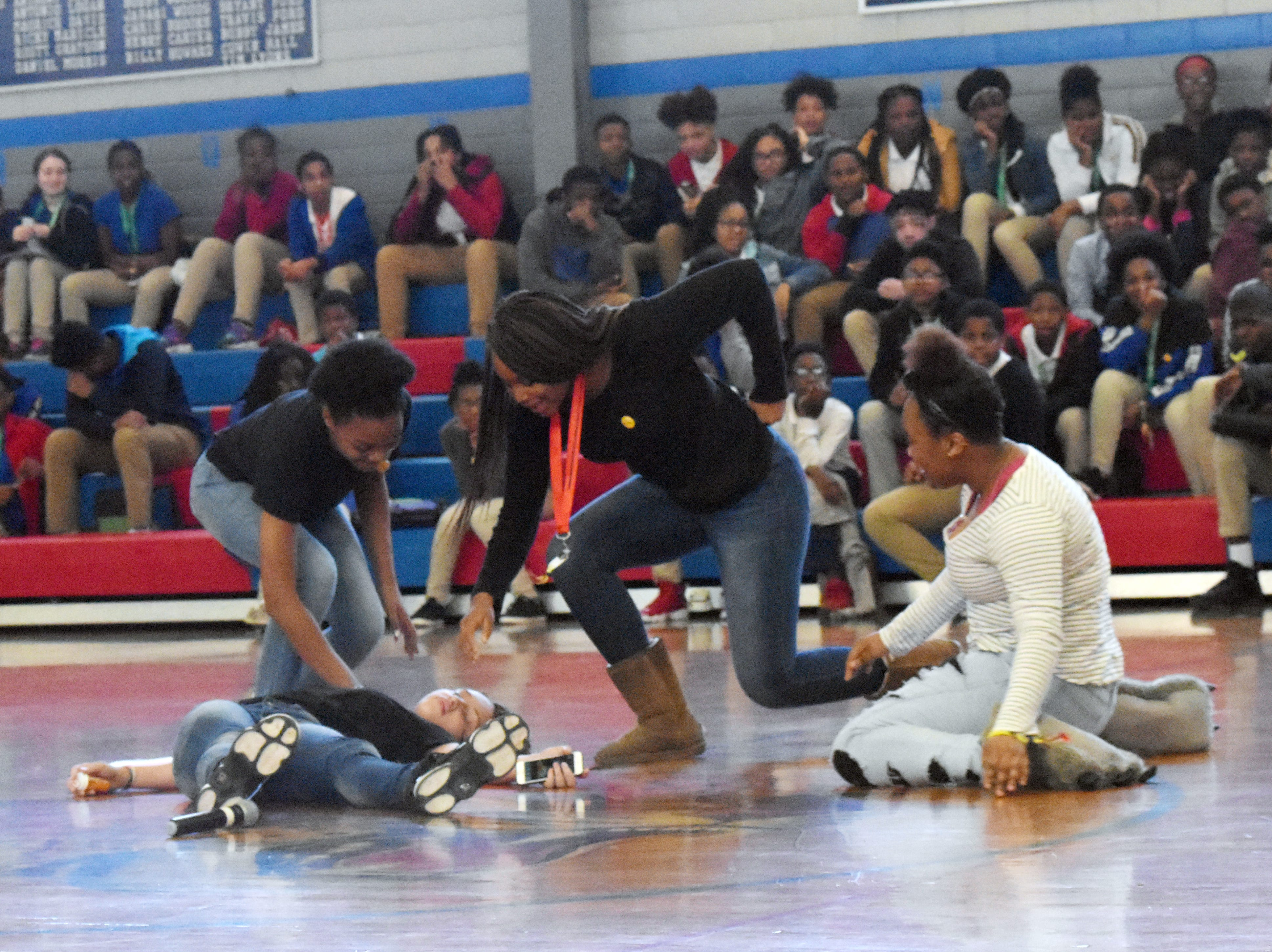 """Members of the Living Healthy Club at Alexandria Middle Magnet School perform a skit about the dangers of drug use during an assembly held Kick Butts Day. The students wrote the skit and came up with the activities for the assembly. AMMS was one of 53 schools in Central Louisiana participating in Kick Butts Day with funding from the Healthy Behaviors School District Partnership Grant from The Rapides Foundation. Kick Butts Day is recognized nationally by young people to raise awareness against the use of tobacco products. A press release from The Rapides Foundation states, """"The Healthy Behaviors School District Partnership Grant seeks to prevent and reduce tobacco use, substance and alcohol abuse, and overweight/obesity by focusing on changing policy, social norms and environments. Grant activities are based on best and promising practices to create comprehensive school- and community-based awareness and prevention programs in order to positively impact Central Louisiana students, educators and staff. The goal is to provide the knowledge and skills necessary to make better and informed behavior decisions leading to healthier lives."""""""