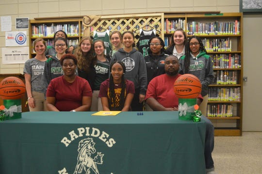 Rapides senior point guard Darlynetta Martin (first row, center) signed with Bossier Parish Community College Wednesday.