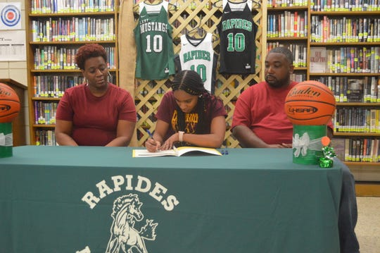 Rapides senior point guard Darlynetta Martin (center) signed with Bossier Parish Community College Wednesday.