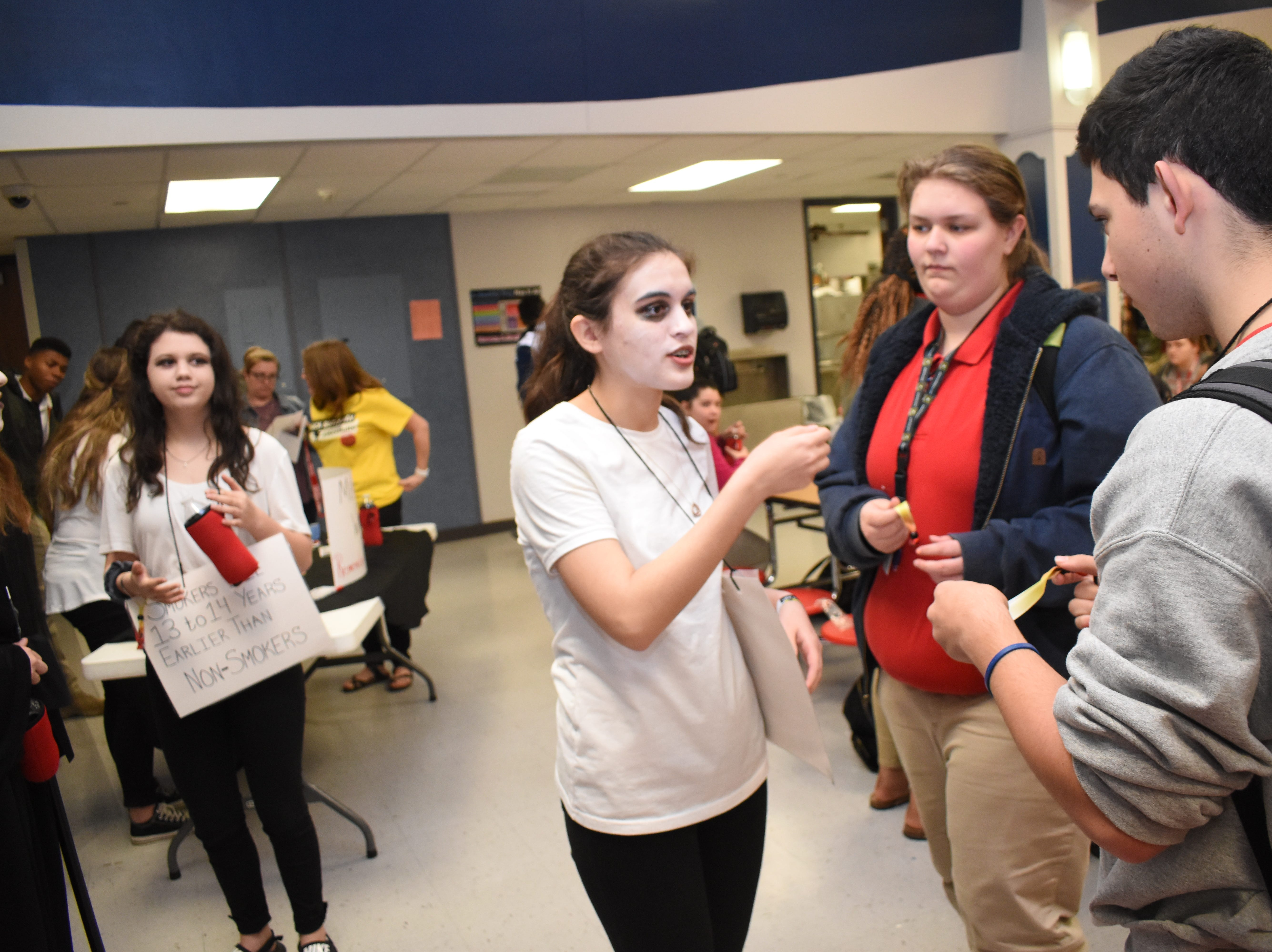"""Members of the Tioga High School Living Healthy Club erected a memorial wall where students could add the name of someone they knew who died from tobacco use. Tioga High School was one of 53 schools in Central Louisiana participating in Kick Butts Day with funding from the Healthy Behaviors School District Partnership Grant from The Rapides Foundation. Kick Butts Day is recognized nationally by young people to raise awareness against the use of tobacco products. A press release from The Rapides Foundation states, """"The Healthy Behaviors School District Partnership Grant seeks to prevent and reduce tobacco use, substance and alcohol abuse, and overweight/obesity by focusing on changing policy, social norms and environments. Grant activities are based on best and promising practices to create comprehensive school- and community-based awareness and prevention programs in order to positively impact Central Louisiana students, educators and staff. The goal is to provide the knowledge and skills necessary to make better and informed behavior decisions leading to healthier lives."""""""