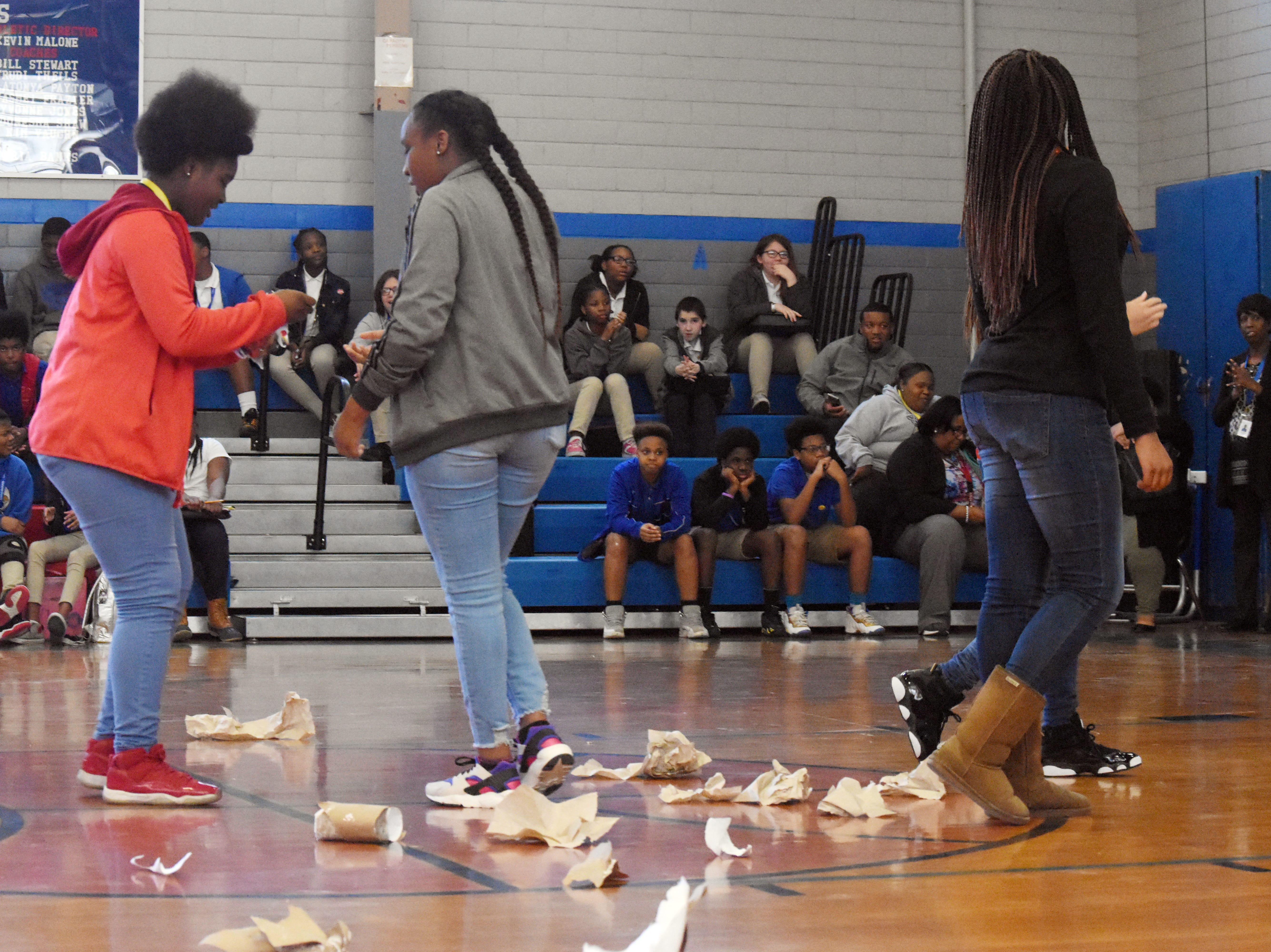 """Members of the Living Healthy Club at Alexandria Middle Magnet School tear up a replica of a cigarette during an assembly held Kick Butts Day. The students came up with the activities for the assembly. AMMS was one of 53 schools in Central Louisiana participating in Kick Butts Day with funding from the Healthy Behaviors School District Partnership Grant from The Rapides Foundation. Kick Butts Day is recognized nationally by young people to raise awareness against the use of tobacco products. A press release from The Rapides Foundation states, """"The Healthy Behaviors School District Partnership Grant seeks to prevent and reduce tobacco use, substance and alcohol abuse, and overweight/obesity by focusing on changing policy, social norms and environments. Grant activities are based on best and promising practices to create comprehensive school- and community-based awareness and prevention programs in order to positively impact Central Louisiana students, educators and staff. The goal is to provide the knowledge and skills necessary to make better and informed behavior decisions leading to healthier lives."""""""