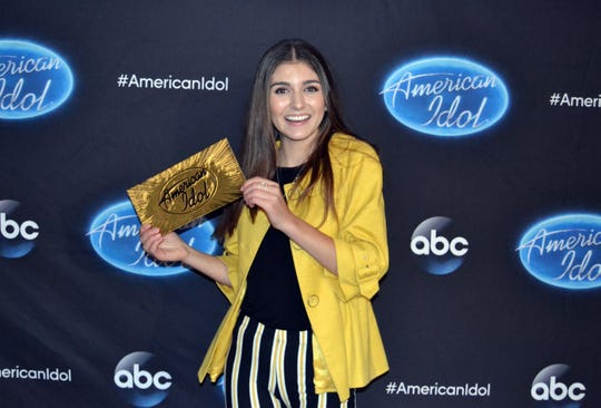 "Franki Moscato, a 17-year-old from Oshkosh, shows off her ticket to the Hollywood round of ""American Idol."""