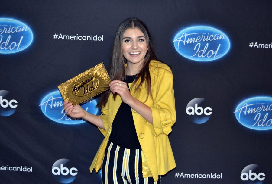 """Franki Moscato, a 17-year-old from Oshkosh, shows off her ticket to the Hollywood round of """"American Idol."""""""