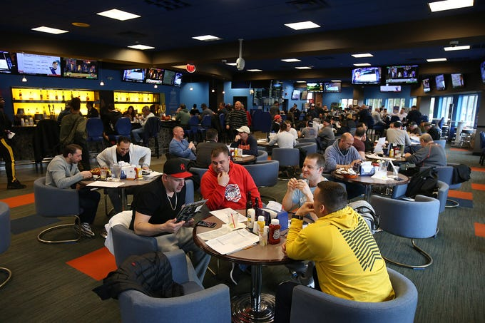 A large lunch crowd watches the Minnesota vs. Louisville game during March Madness, the NCAA men's college basketball tournament, at Monmouth Park's William Hill Race and Sports Bar in Oceanport, NJ Thursday March 21, 2019.