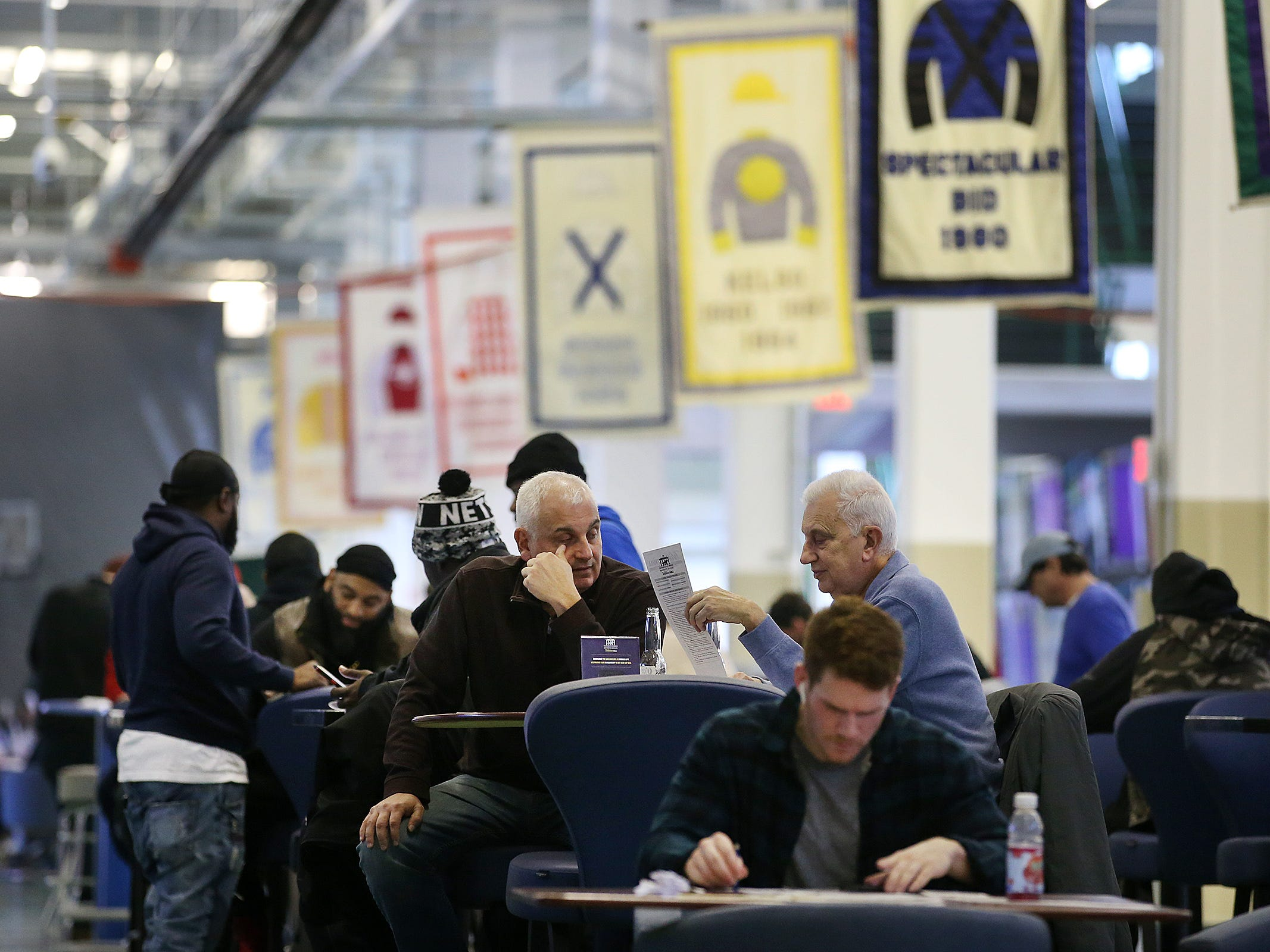 Guests prepare to make their bets during March Madness, the NCAA men's college basketball tournament, at Monmouth Park's William Hill Sports Book in Oceanport, NJ Thursday March 21, 2019.