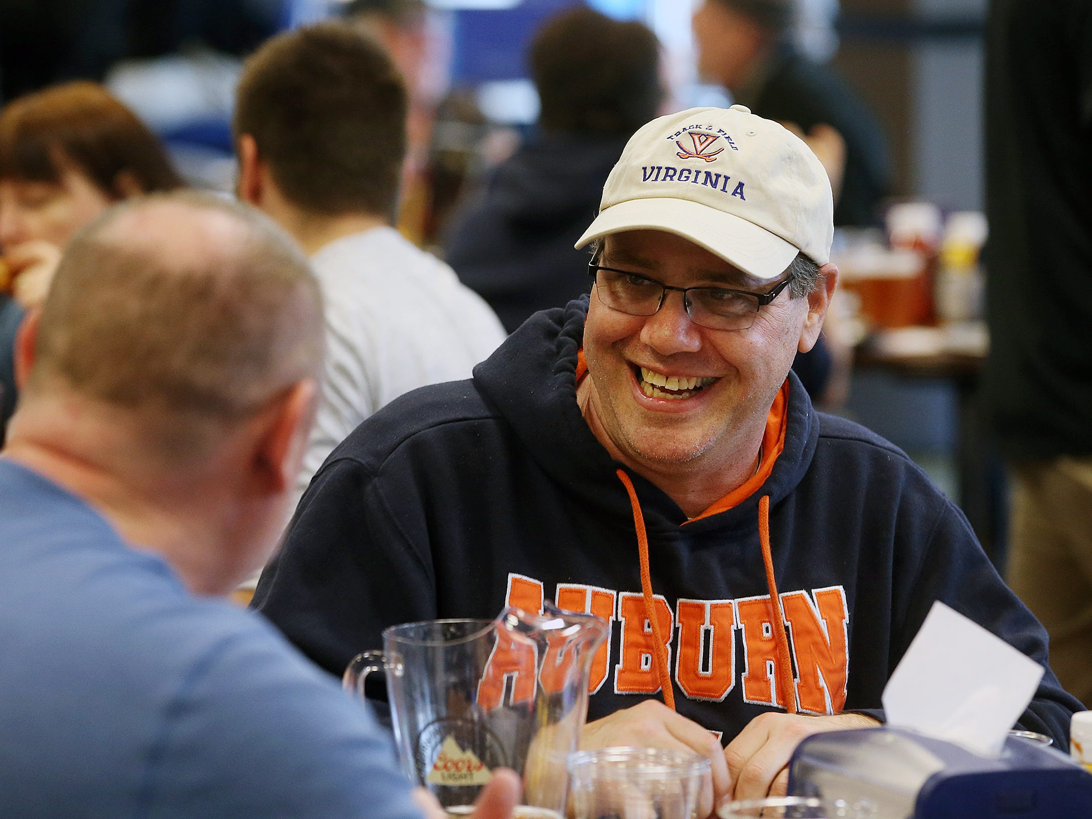 Jack Giannattasio of Colts Neck wears an Auburn sweatshirt as he watches basketball with friends during March Madness, the NCAA men's college basketball tournament, at Monmouth Park's William Hill Race and Sports Bar in Oceanport, NJ Thursday March 21, 2019.