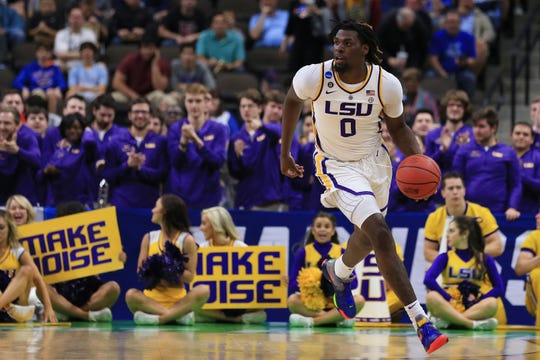 LSU Tigers forward Naz Reid (0) brings the ball up court against the Yale Bulldogs during the first half in the first round of the 2019 NCAA Tournament