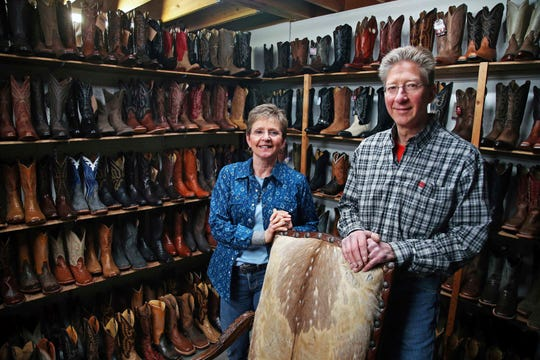Deb and Kevin Durken pose in their boot store, The Boot Shack in St. Cloud, Minn. The bookkeeper for the Durkens' store forged checks and stole an estimated $225,000 over 10 years, Deb says. The bookkeeper was able to keep stealing because she was trusted to do her work unsupervised.