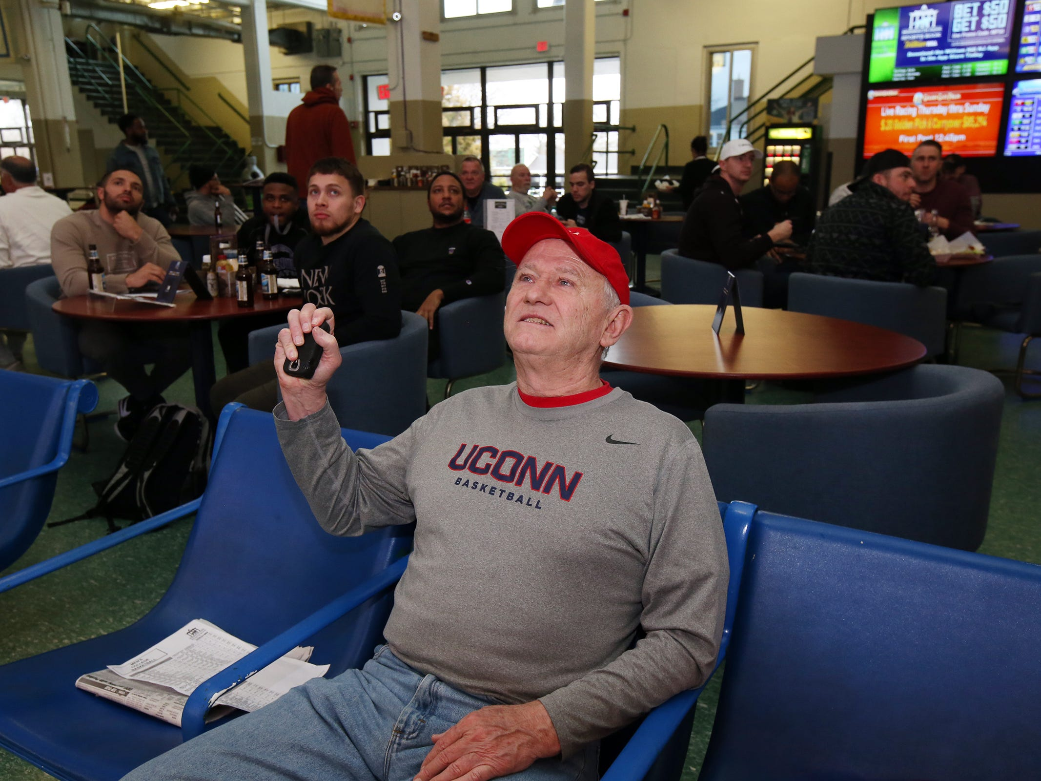 Paul Travers of Oceanport watches the Minnesota vs. Louisville game during March Madness, the NCAA men's college basketball tournament, at Monmouth Park's William Hill Sports Book in Oceanport, NJ Thursday March 21, 2019.
