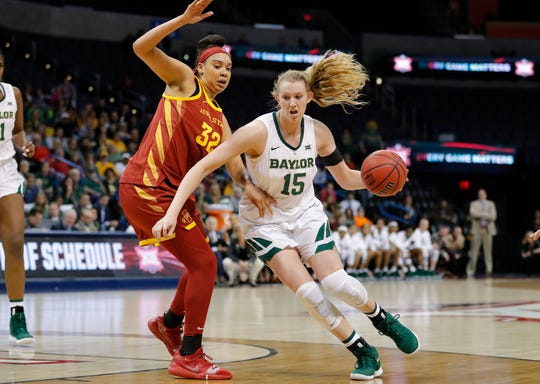 Baylor forward Lauren Cox (15) drives to the basket around Iowa State forward Meredith Burkhall (32) during the first half of the Big 12 women's conference tournament championship in Oklahoma City, Monday, March 11, 2019. (AP Photo/Alonzo Adams)