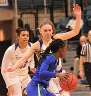 ACU's Breanna Wright, center, defends against a Texas A&M-Corpus Christi player as Makayla Mabry looks on. ACU beat the Islanders 69-68 in the Southland Conference women's tournament championship game March 17 at the Merrell Center in Katy.