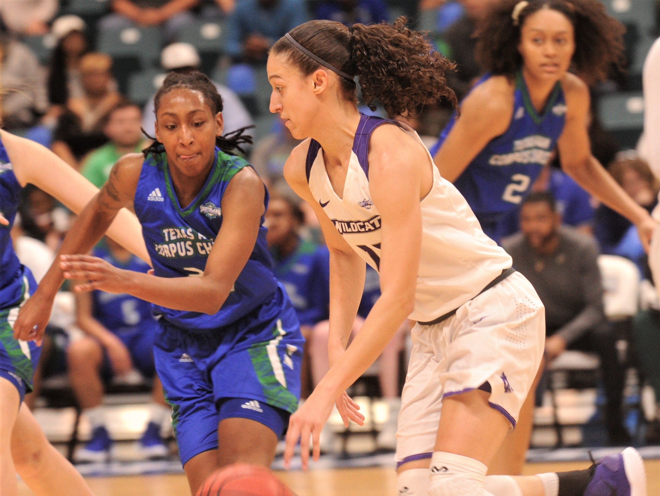 ACU's Sara Williamson brings the ball up court as a Texas A&M-Corpus Christi player defends. ACU beat the Islanders 69-68 in the Southland Conference women's tournament championship game Sunday, March 17, 2019, at the Merrell Center in Katy.