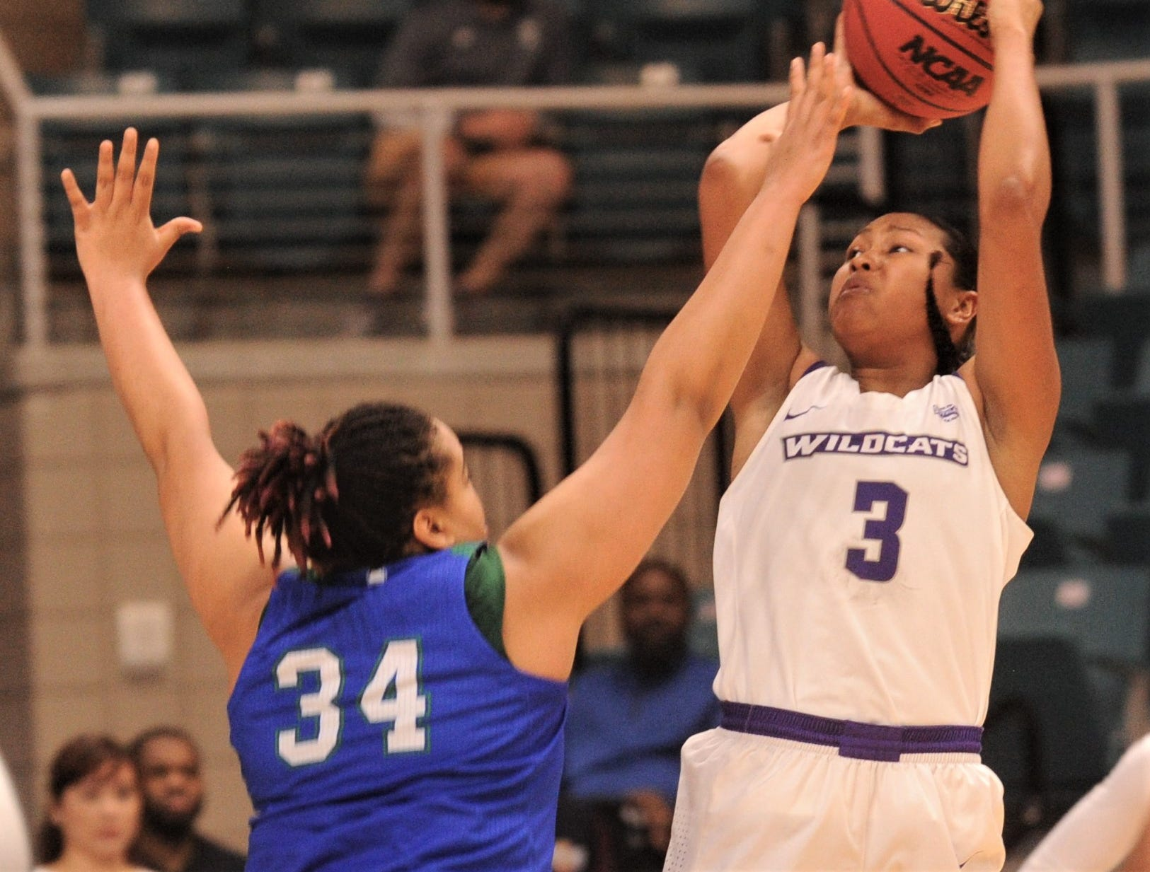 Dominique Golightly (30) shoots over Texas A&M-Corpus Christi's Tiara Matthews in the Southland Conference Tournament championship game. ACU beat the Islanders 69-68 for the title Sunday, March 17, 2019, at the Merrell Center in Katy.
