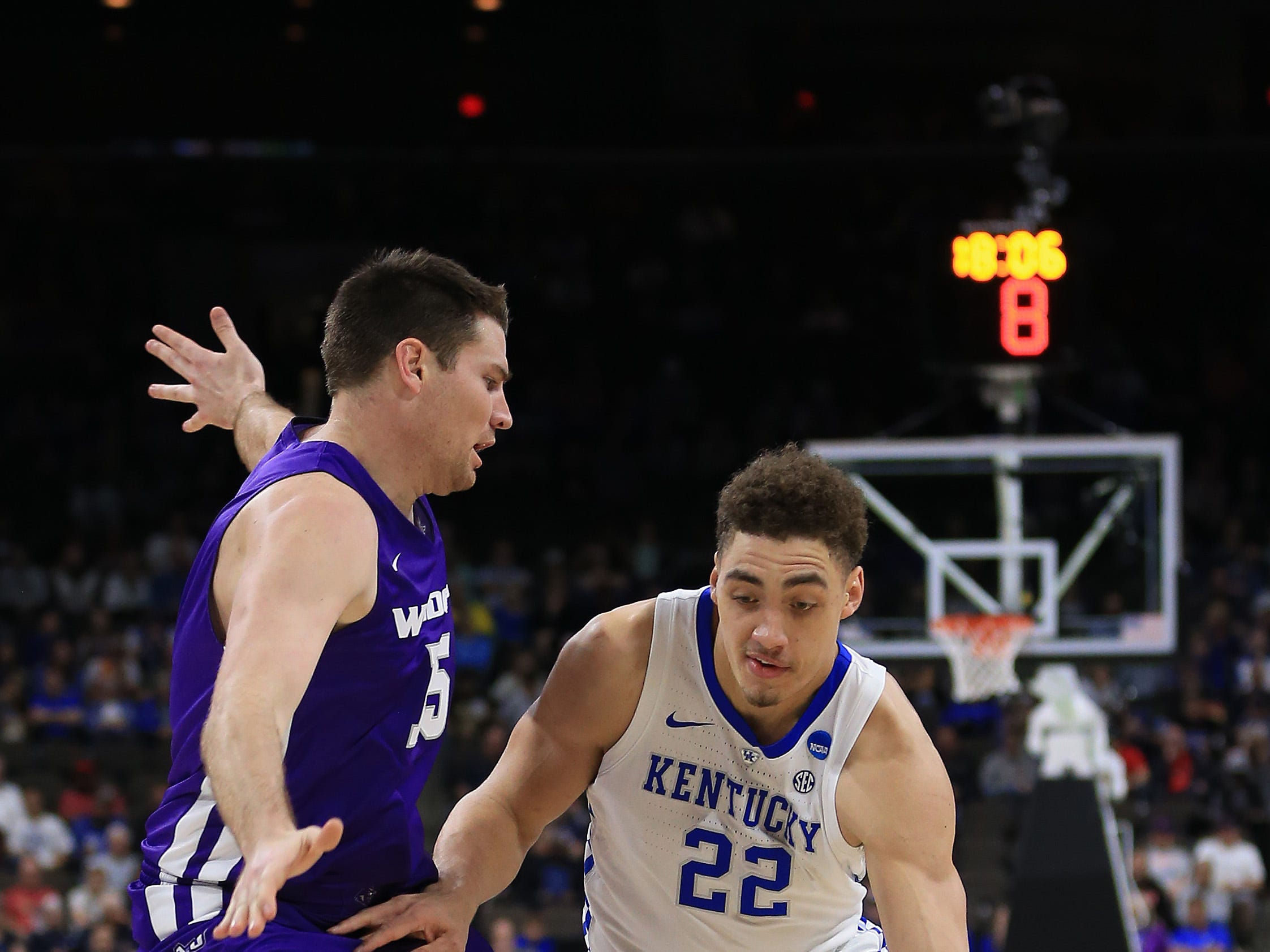 Mar 21, 2019; Jacksonville, FL, USA; Kentucky Wildcats forward Reid Travis (22) dribbles the ball around Abilene Christian Wildcats forward Hayden Farquhar (15) during the first quarter in the first round of the 2019 NCAA Tournament at Jacksonville Veterans Memorial Arena. Mandatory Credit: Matt Stamey-USA TODAY Sports