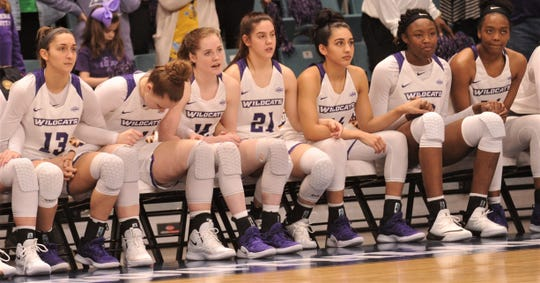 ACU's Madi Miller, near left, can't watch as the rest of the bench looks on as teammate Breanna Wright shoots two free throws with the Wildcats' leading Texas A&M-Corpus Christi by a point with seven seconds left in the game. Wright hit both free throws, and they proved to be the game-winning points in a 69-68 victory over the Islanders in the Southland Conference Tournament championship game Sunday, March 17, 2019, at the Merrell Center in Katy.