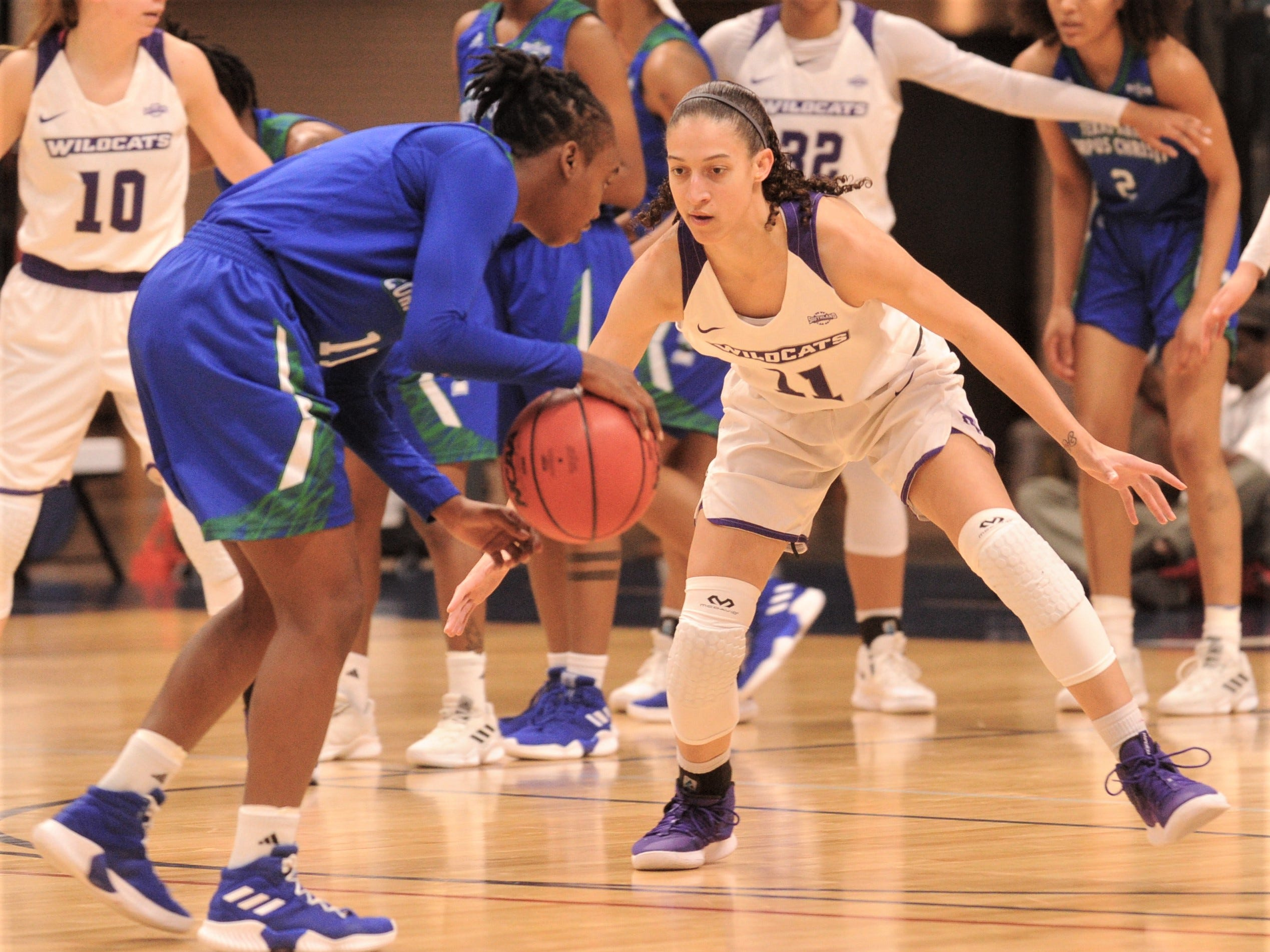 ACU's Sara Williamson, right, defends against a Texas A&M-Corpus Christi player. ACU beat the Islanders 69-68 in the Southland Conference women's tournament championship game Sunday, March 17, 2019, at the Merrell Center in Katy.