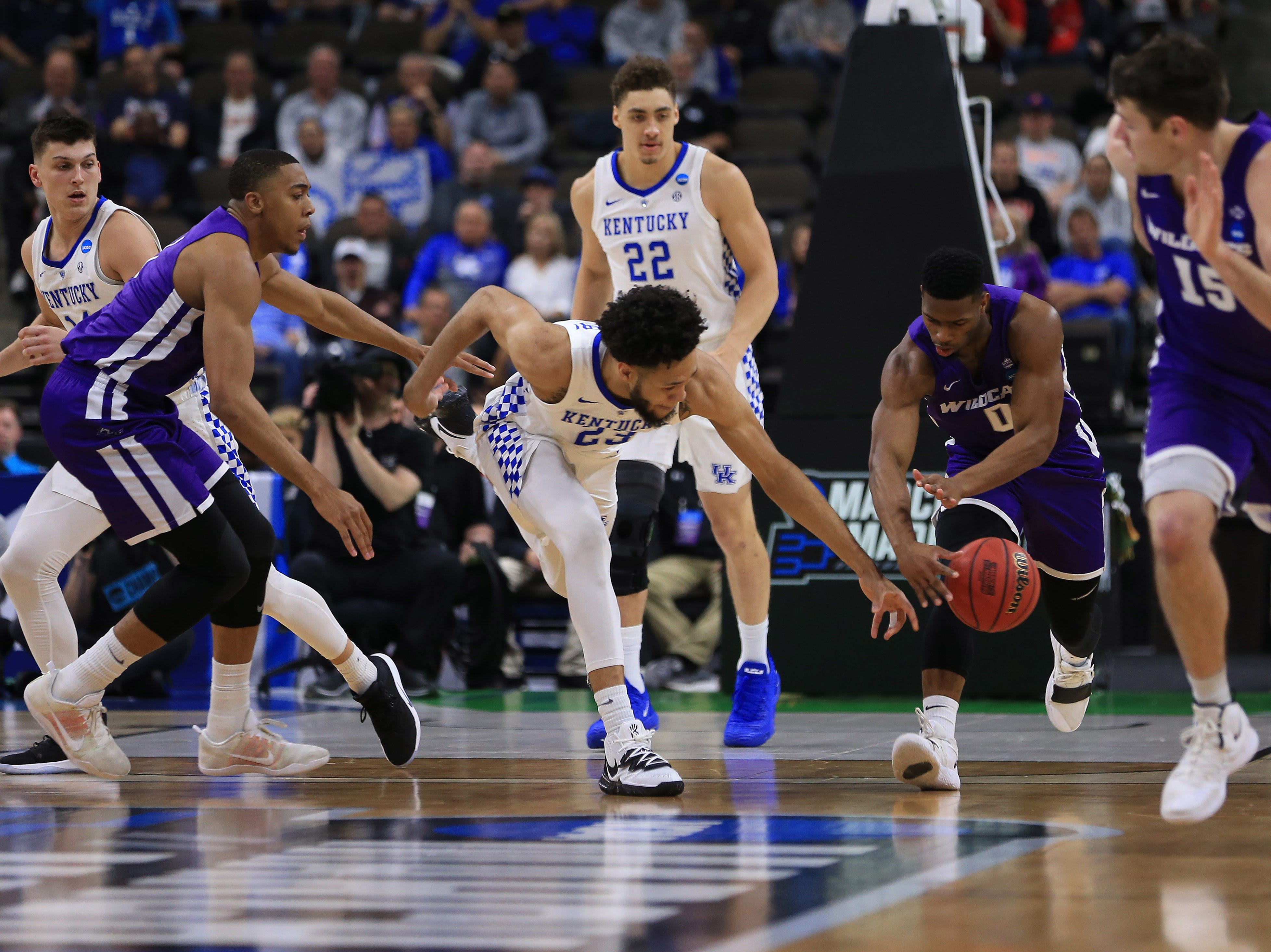 Mar 21, 2019; Jacksonville, FL, USA; Kentucky Wildcats forward EJ Montgomery (23) and Abilene Christian Wildcats guard Jaylen Franklin (0) battle for the ball during the first quarter in the first round of the 2019 NCAA Tournament at Jacksonville Veterans Memorial Arena. Mandatory Credit: Matt Stamey-USA TODAY Sports