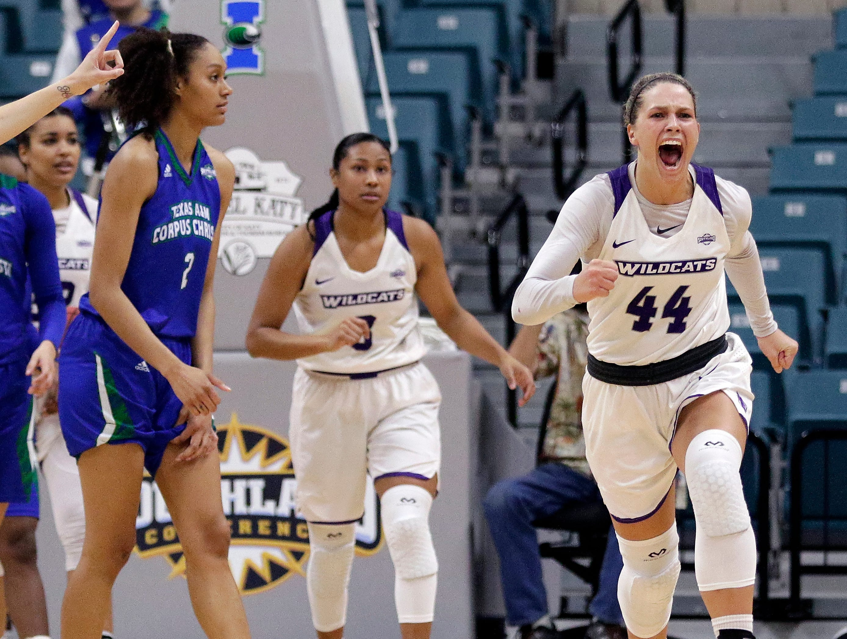 Texas A&M-Corpus Christi forward Alexes Bryant, left, looks on as Abilene Christian guard Dominique Golightly (3) and forward Lexie Ducat (44) react after Abilene Christian's won the Southland Conference women's tournament title Sunday, March 17, 2019, in Katy.