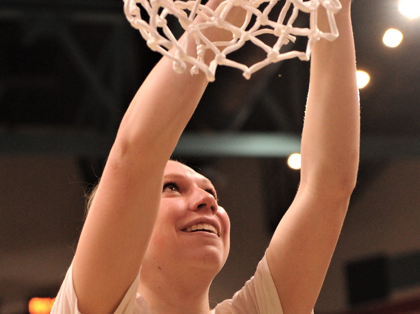 ACU junior Breanna Wright cuts a portion of the net after the Wildcats' beat Texas A&M-Corpus Christi 69-68 in the Southland Conference Tournament championship game Sunday, March 17, 2019, at the Merrell Center in Katy.