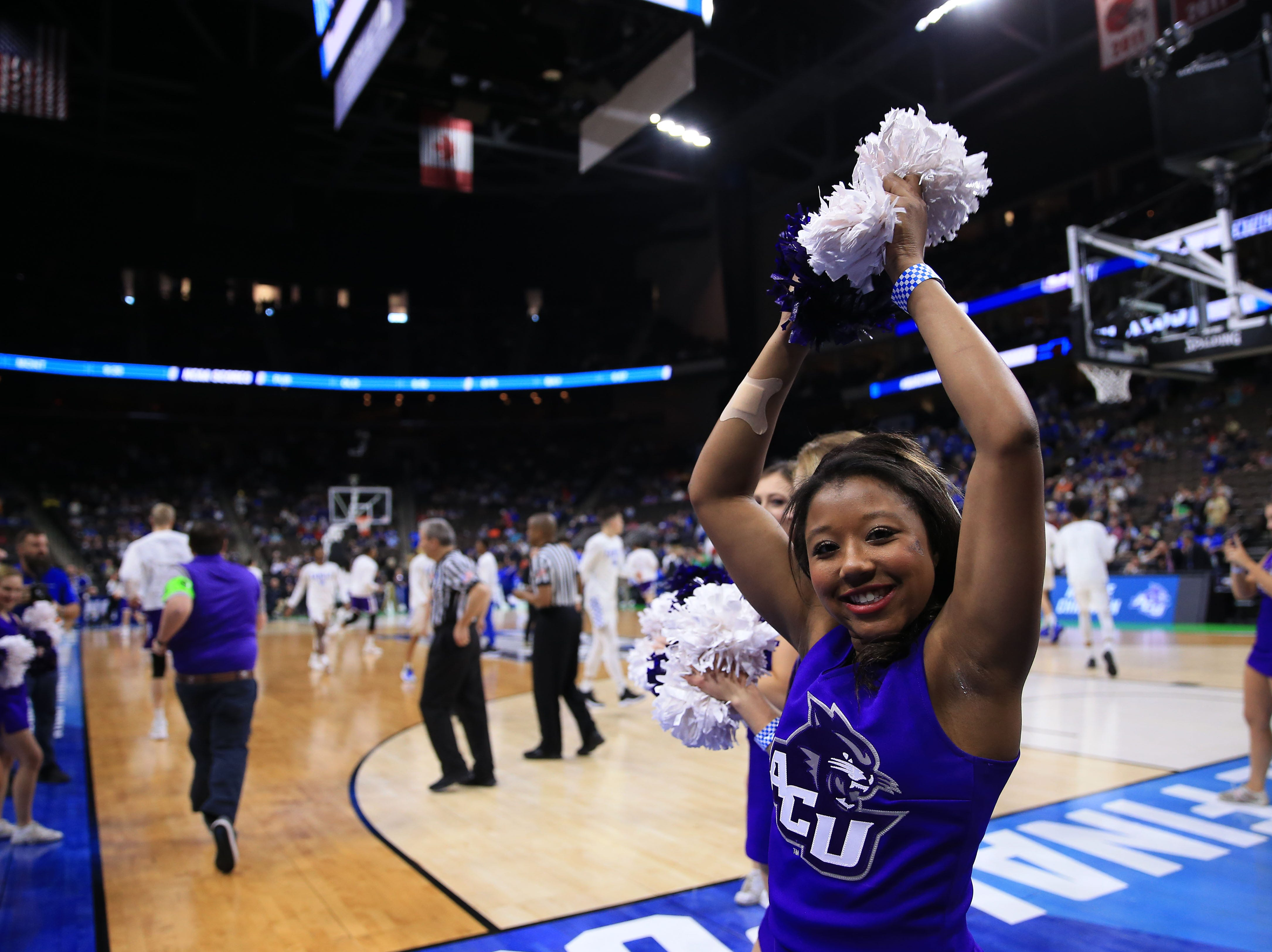 Mar 21, 2019; Jacksonville, FL, USA; The Abilene Christian Wildcats cheerleaders look on from the court prior to the first round of the 2019 NCAA Tournament against the Kentucky Wildcats at Jacksonville Veterans Memorial Arena. Mandatory Credit: Matt Stamey-USA TODAY Sports