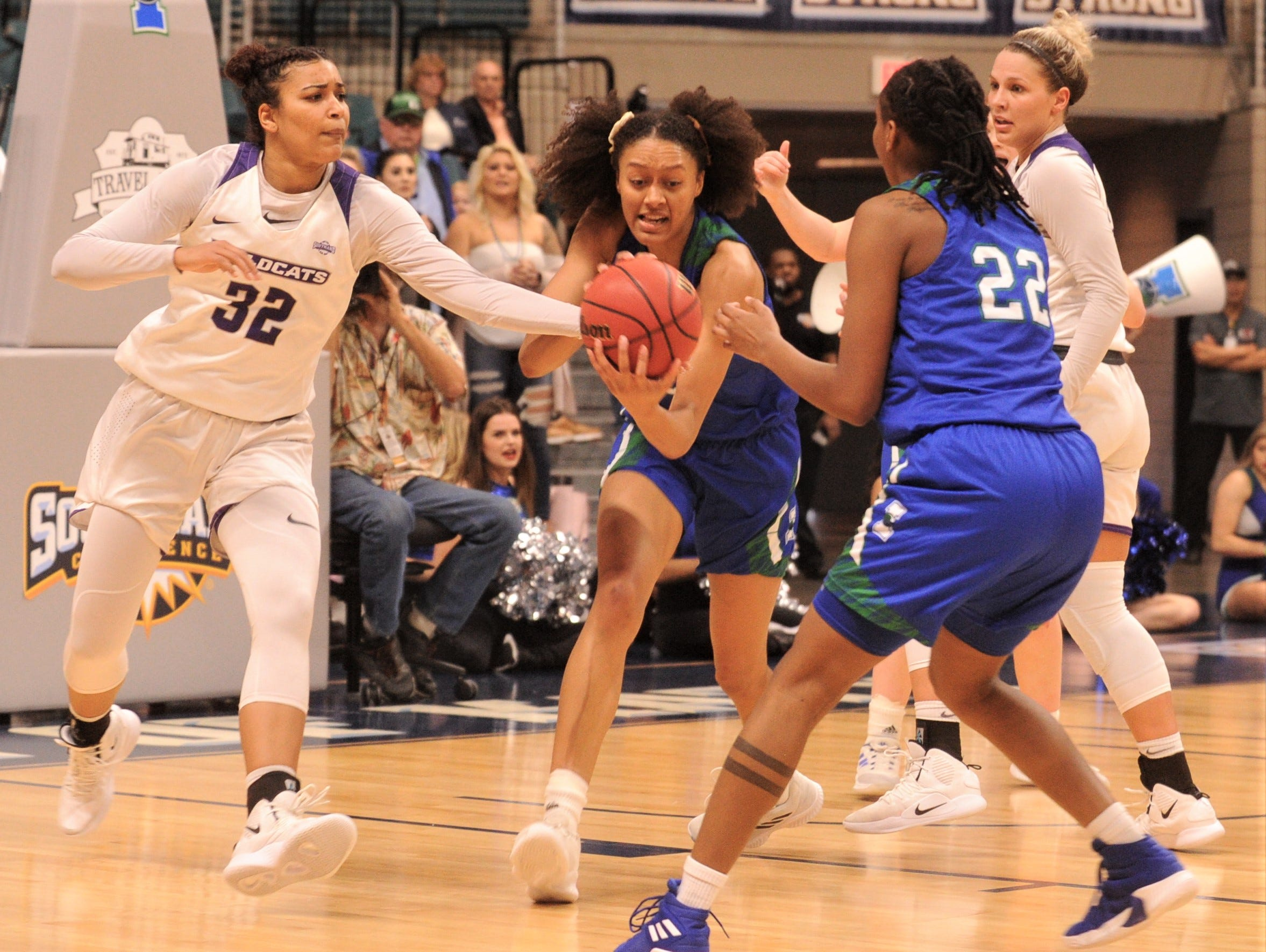 ACU's Makayla Mabry, left, battles Texas A&M-Corpus Christi's Alexes Bryant, center, for a rebound as Dalesia Booth (22) and ACU's Lexie Ducat look on. ACU beat the Islanders 69-68 in the Southland Conference women's tournament championship game Sunday, March 17, 2019, at the Merrell Center in Katy.