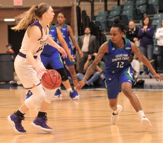 Texas A&M-Corpus Christi's Dae Dae Evans, right, eyes the ball as ACU's Breanna Wright looks to pass the ball. ACU beat the Islanders 69-68 in the Southland Conference women's tournament championship game Sunday, March 17, 2019, at the Merrell Center in Katy.