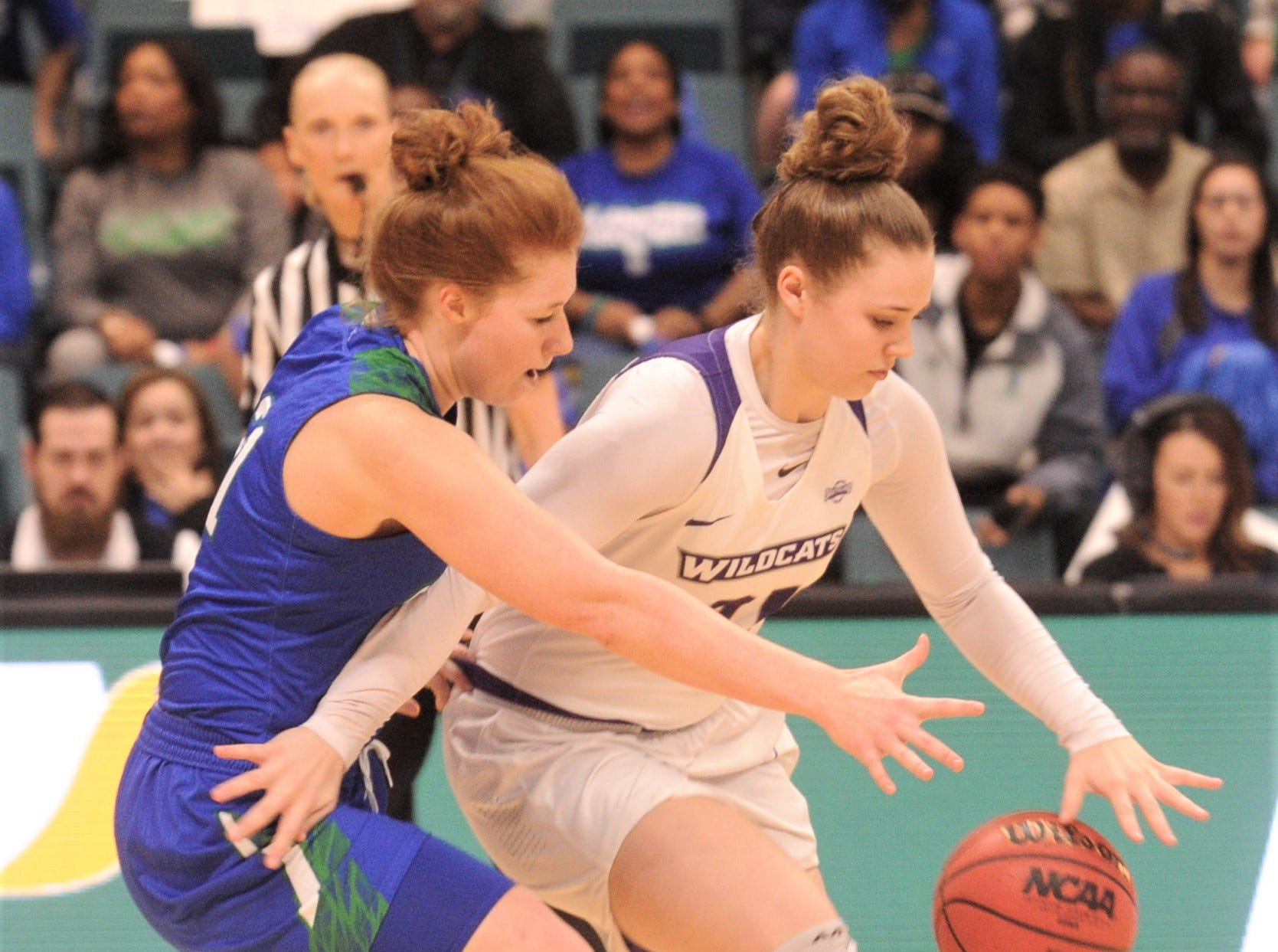 Texas A&M-Corpus Christi's Emma Young, left, tries to knock the ball away from ACU's Madi Miller. ACU beat the Islanders 69-68 in the Southland Conference women's tournament championship game Sunday, March 17, 2019, at the Merrell Center in Katy.