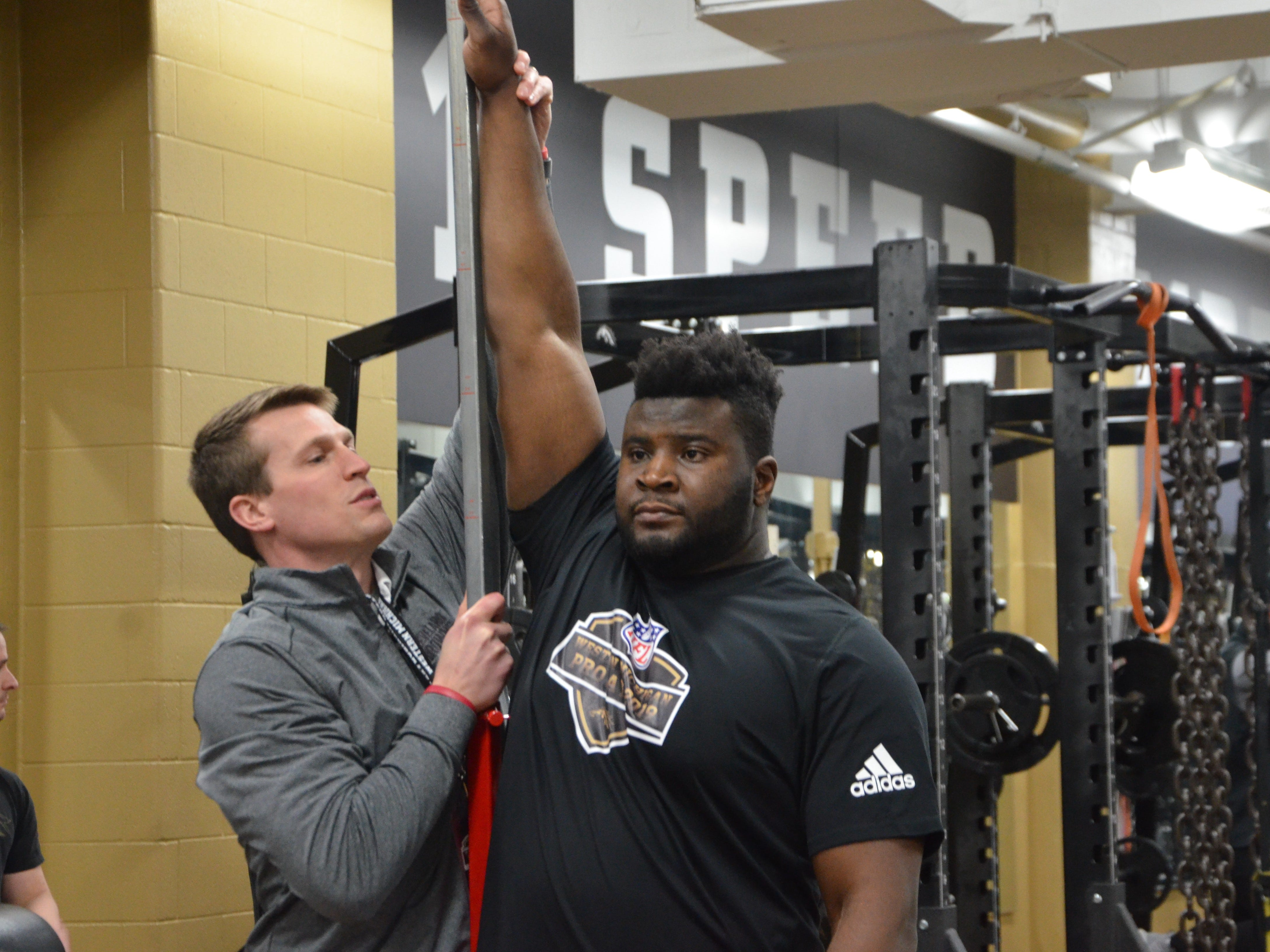 Western Michigan tight end Odell Miller prepares to do a vertical jump drill in front of NFL scouts at the Broncos' Pro Day on Thursday, March 21, 2019.