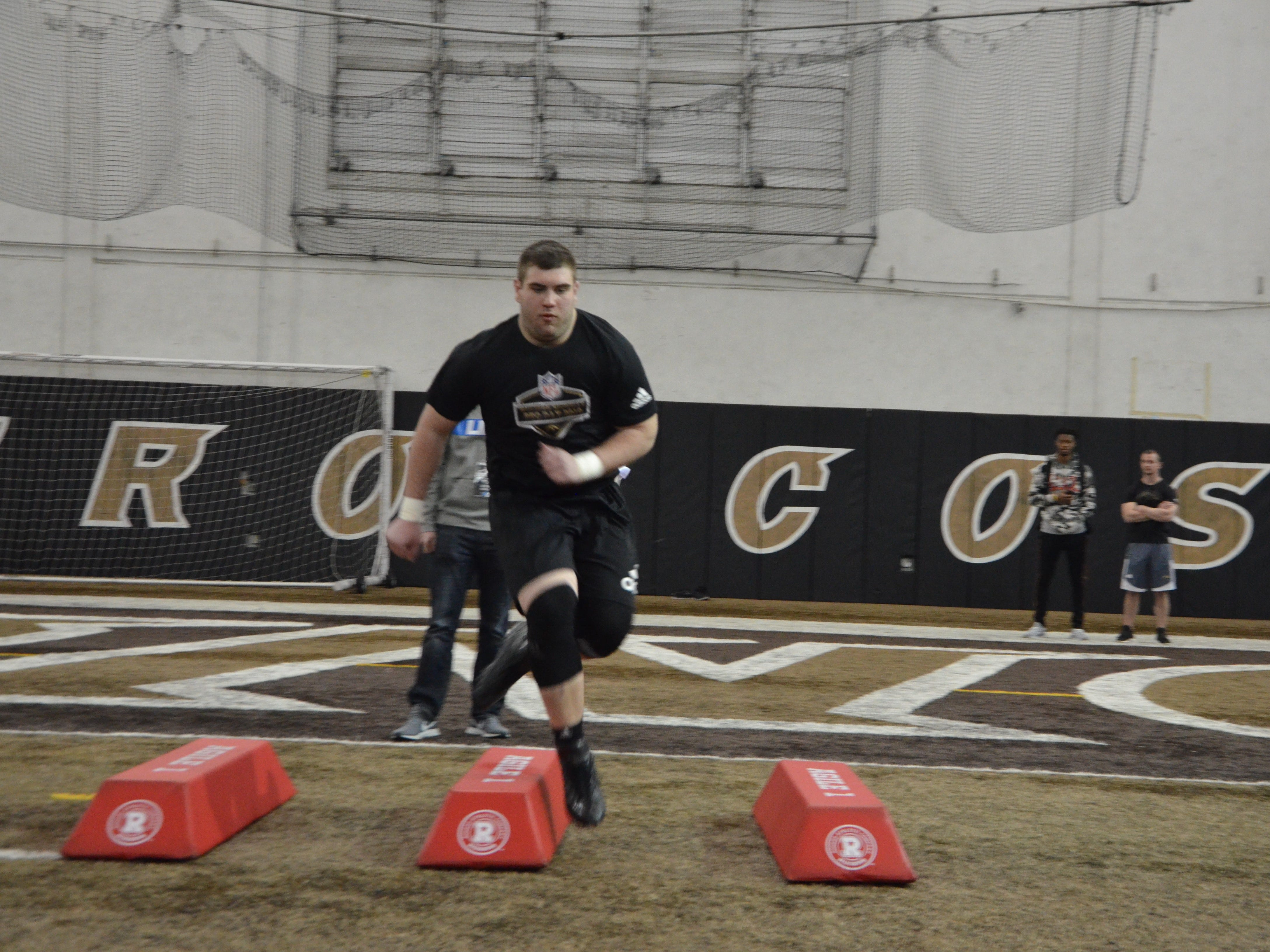 Western Michigan center John Keenoy performs a drill in front of NFL scouts at the Broncos' Pro Day on Thursday, March 21, 2019.
