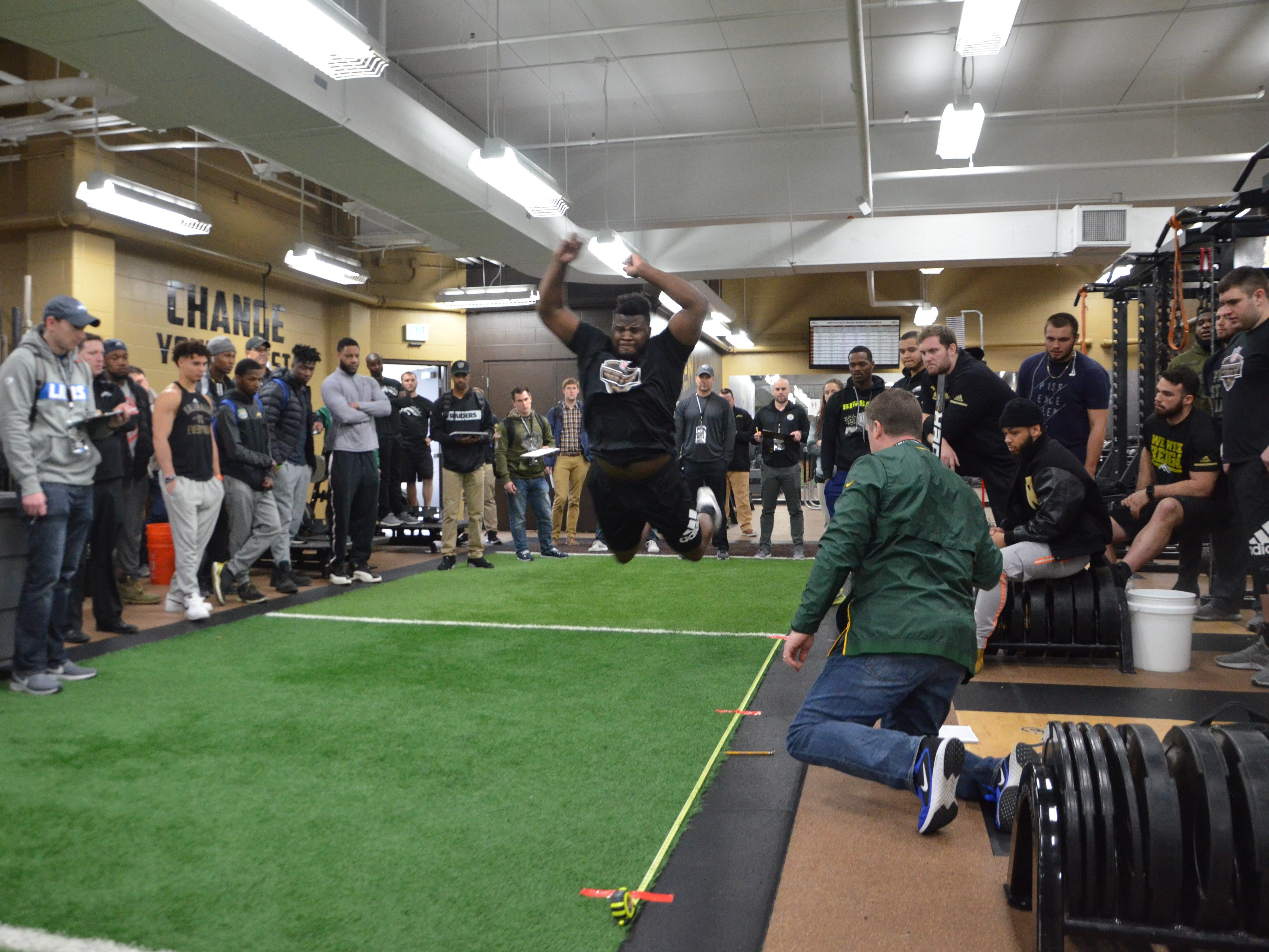 Western Michigan tight end Odell Miller performs a broad jump in front of NFL scouts at the Broncos' Pro Day on Thursday, March 21, 2019.