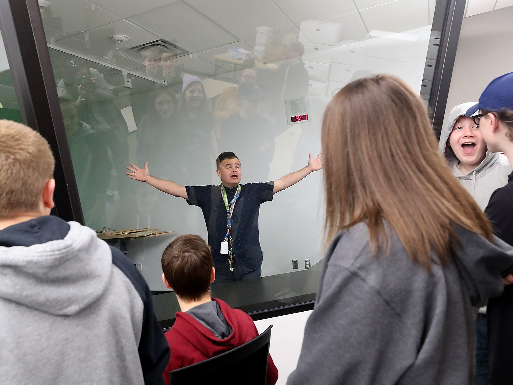 Teacher Michael Brenner gives a shout as he demonstrates the soundproof room - which resembles an aviation control tower - that he and students will use for his Aviation classes at the new Central Kitsap Middle School on Thursday, March 21, 2019. Students got a sneak peek of the school and a few of their classrooms throughout the week.