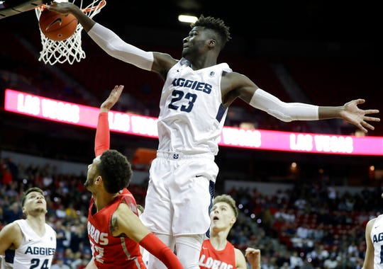 Utah State's Neemias Queta blocks a shot from New Mexico's Anthony Mathis during the Mountain West Conference tournament. The freshman big man was a surprising star for an Aggie team that surpassed expectations in its run to the NCAA tournament.