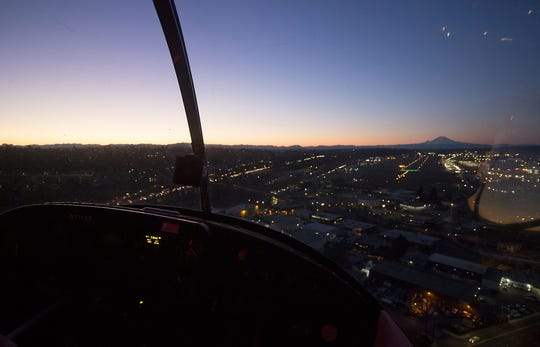 Jason Alferness begins his descent into Boeing Field as the sun begins to rise during his morning commute on Tuesday.